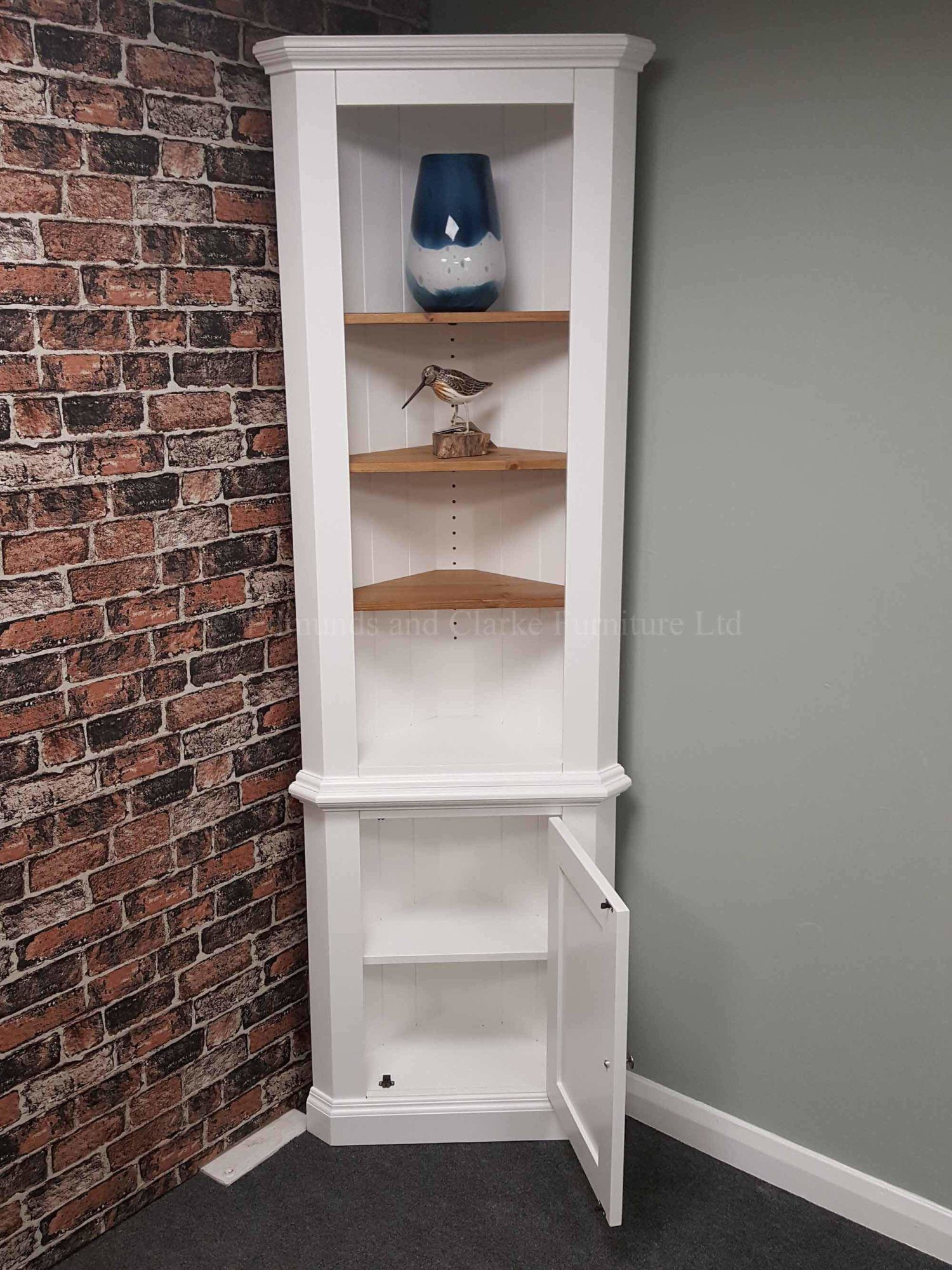 Tall narrow painted corner cupboard with waxed wooden shelves
