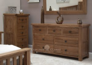 Lavenham solid rustic oak multi drawer chest rustic oak with dark knobs