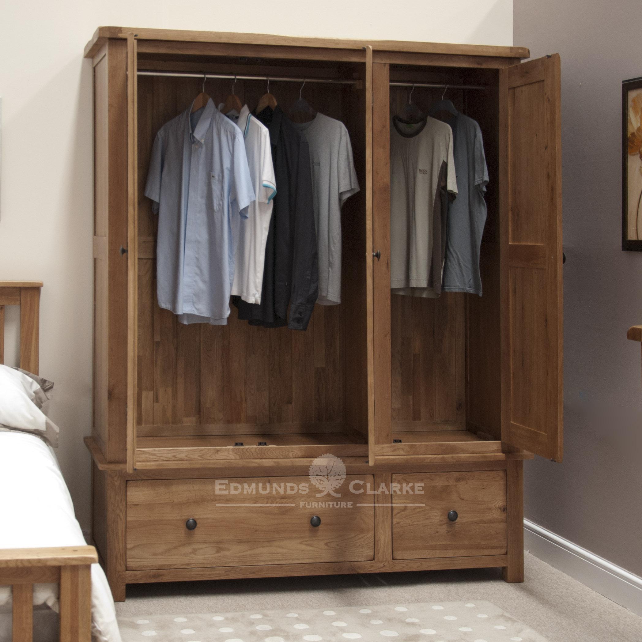 Solid oak triple wardrobe three door and two deep drawers