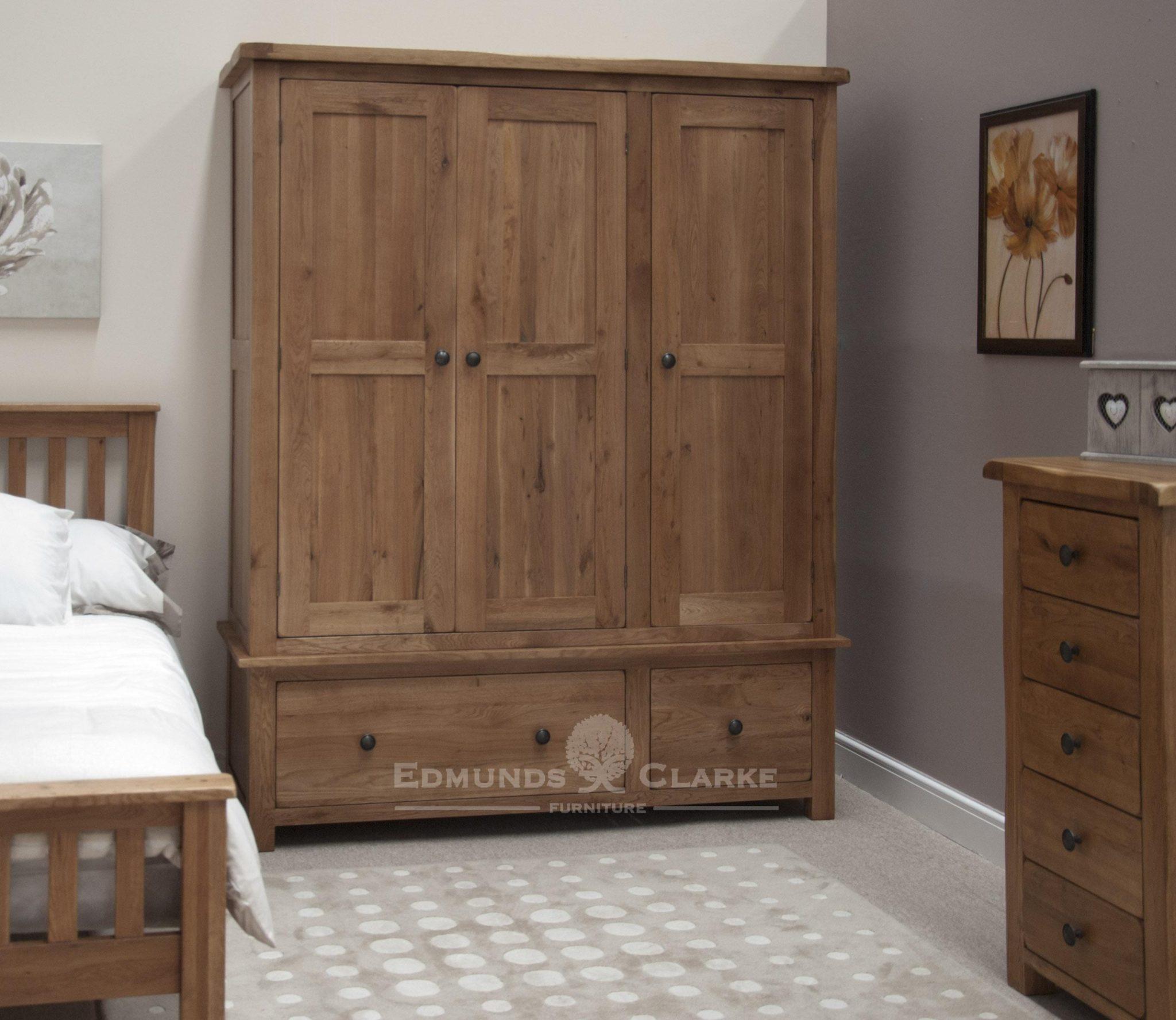 Lavenham solid rustic oak dark large triple wardrobe. with 2 drawers rustic handles, dovetailed joints dark rustic oak