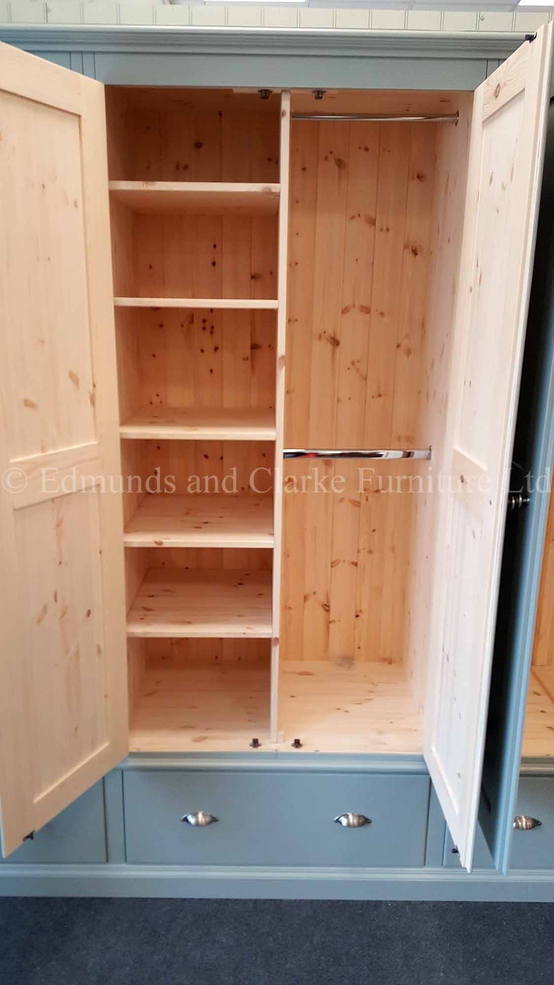 Bespoke painted wardrobe with hanging rail and shelves internally