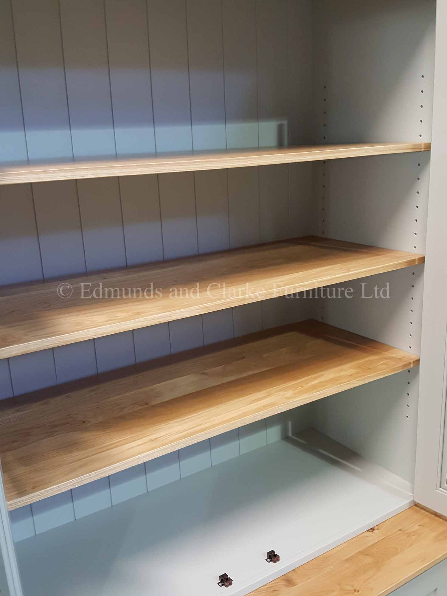 Workstation and shelving with glazed doors and adjustable shelves painted