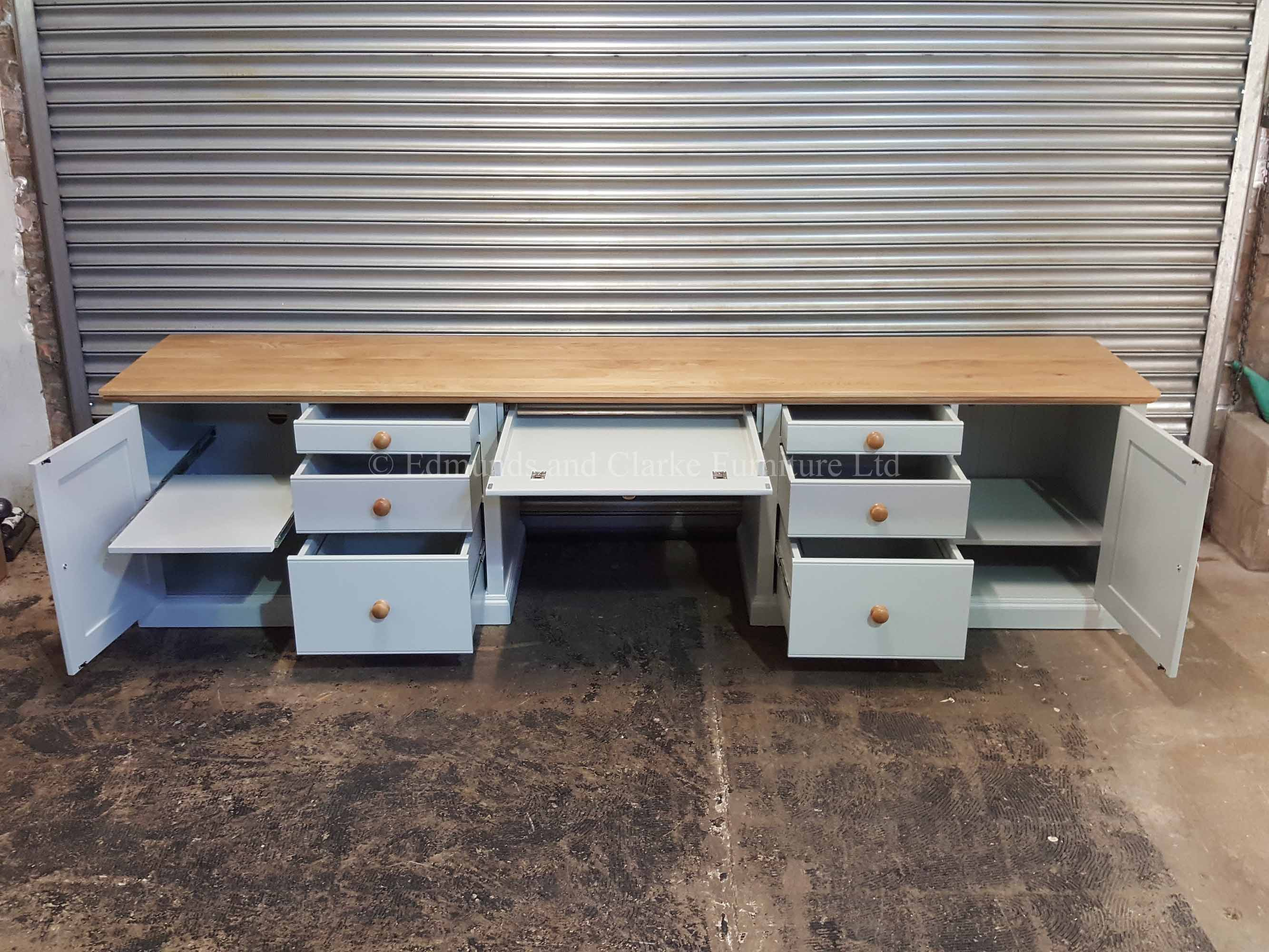 Large bespoke office workstation with two doors six drawers and pull out slide for keyboard