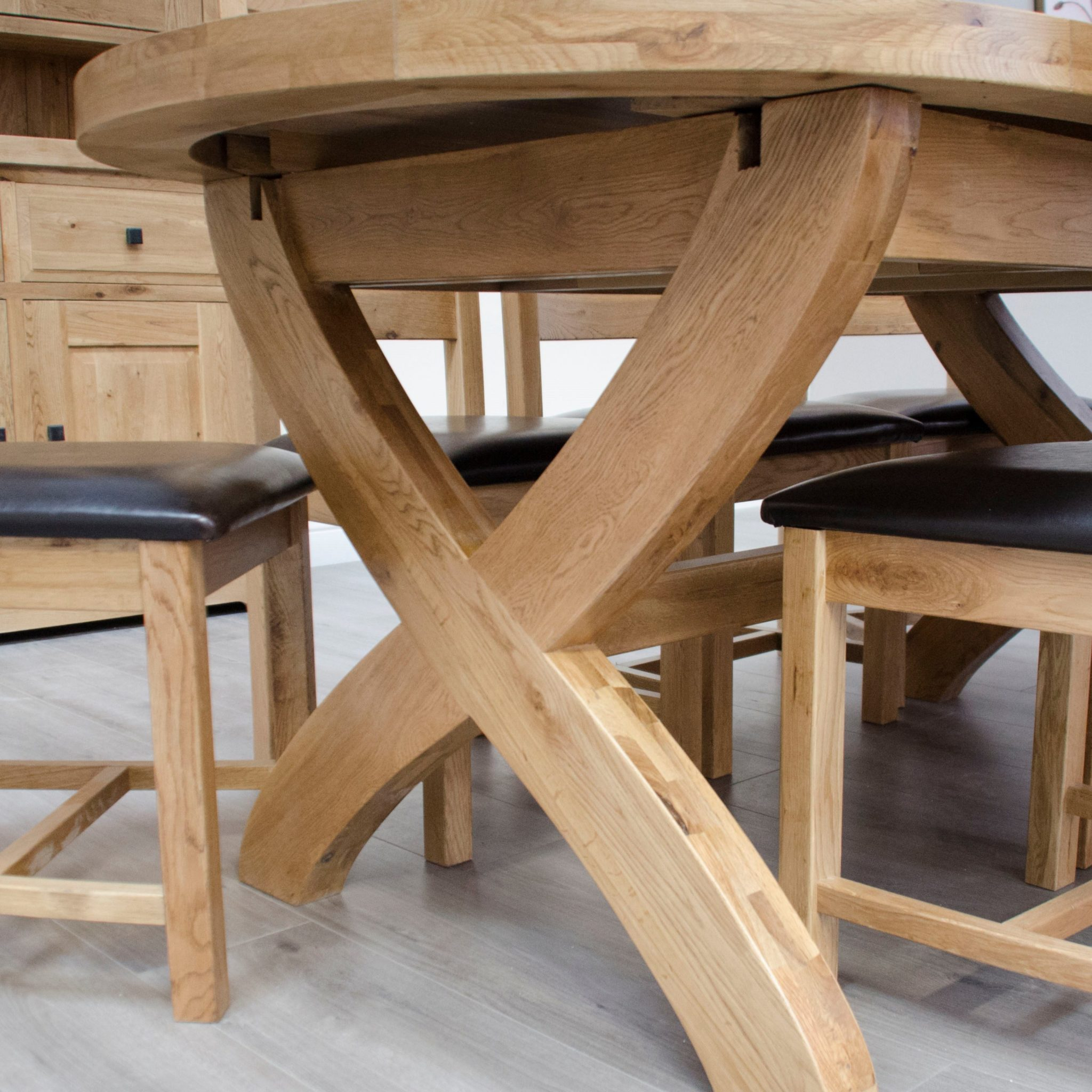 Melford Solid Oak Oval X Leg extending dining table, 180cm closed and extends to 280cm with 2 leaves.
