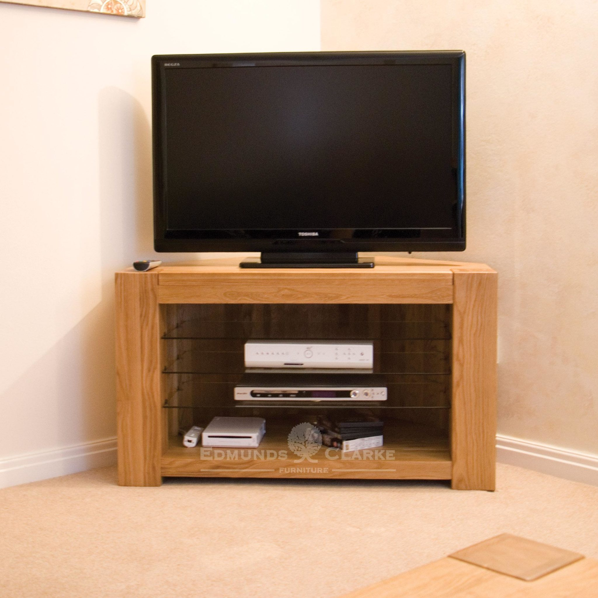 Newmarket solid oak corner tv unit with glass shelves