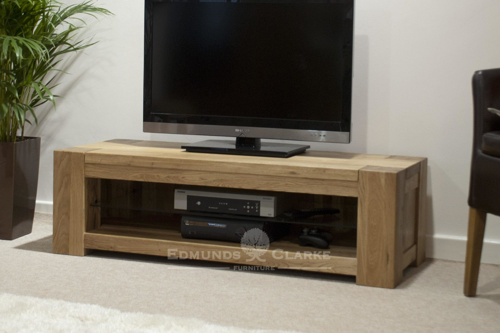 Newmarket wide tv entertainment stand one adjustable glass shelf