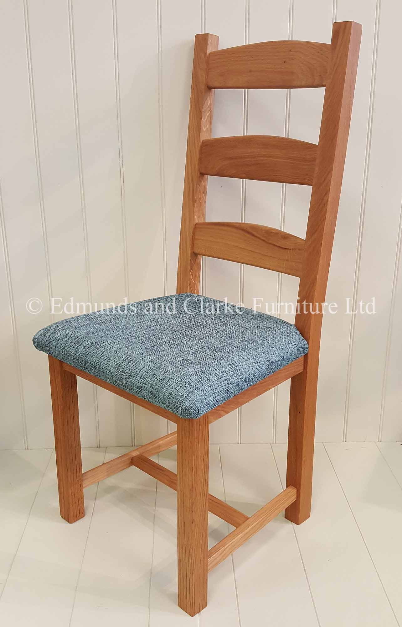 Edmunds Amish Oak dining chair with choice of seat pads. available in light lacquered oak or oiled oak finish. three wide horizontal slats on the back. available only at Edmunds and clarke bury st edmunds