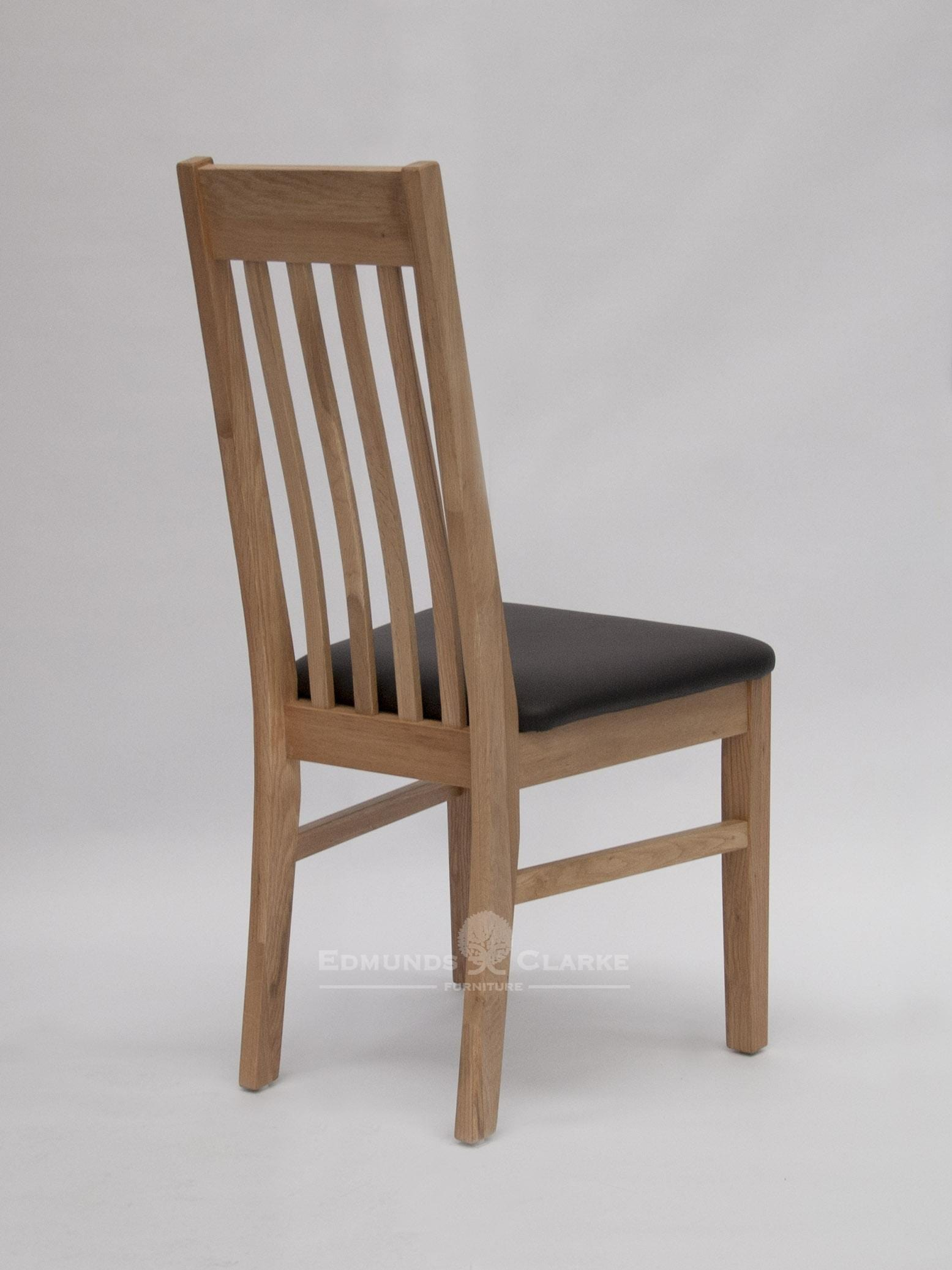 Sophia oak dining chair. slatted back with small lumbar support and faux leather seat pad for extra comfort