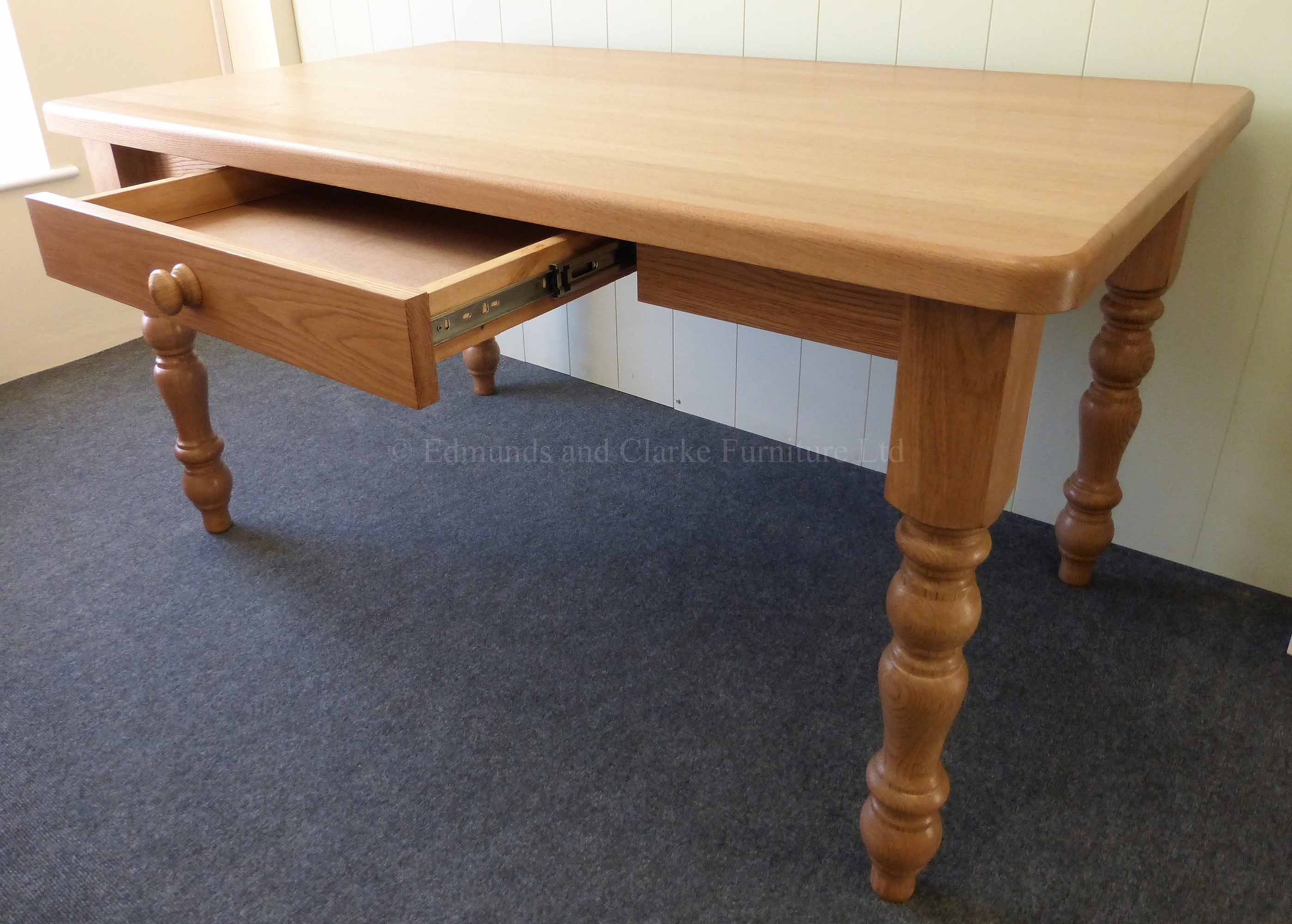 Edmunds Farmhouse solid oak table with turned legs and drawer in side