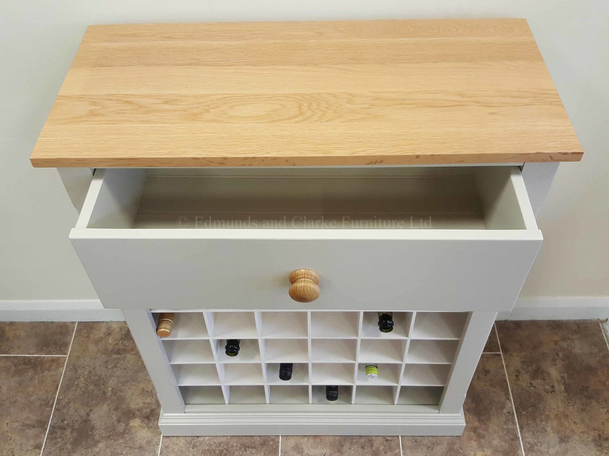 Wine rack painted with solid oak top holds 36 bottles