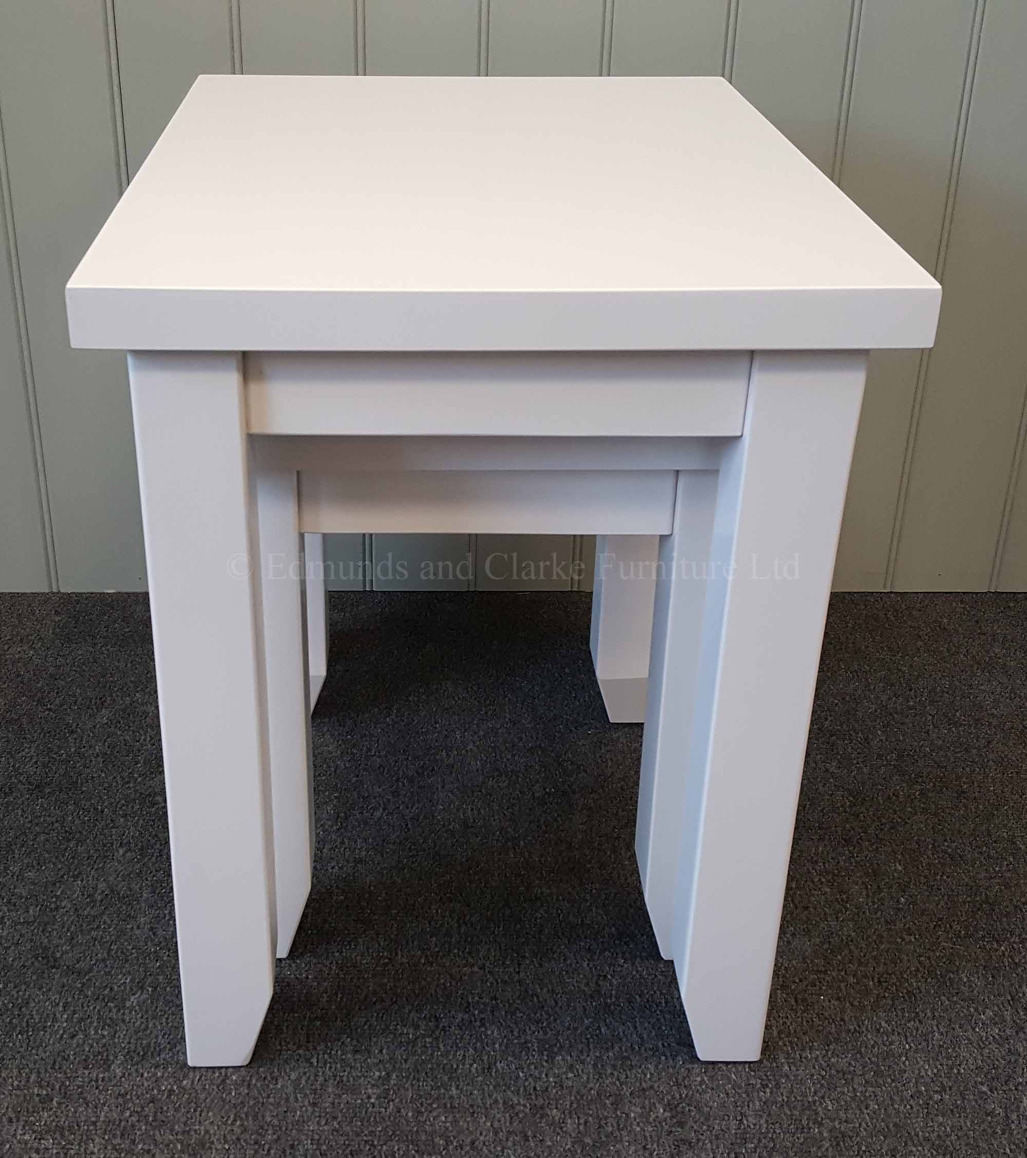 Nest of two tables painted white all over square edge design