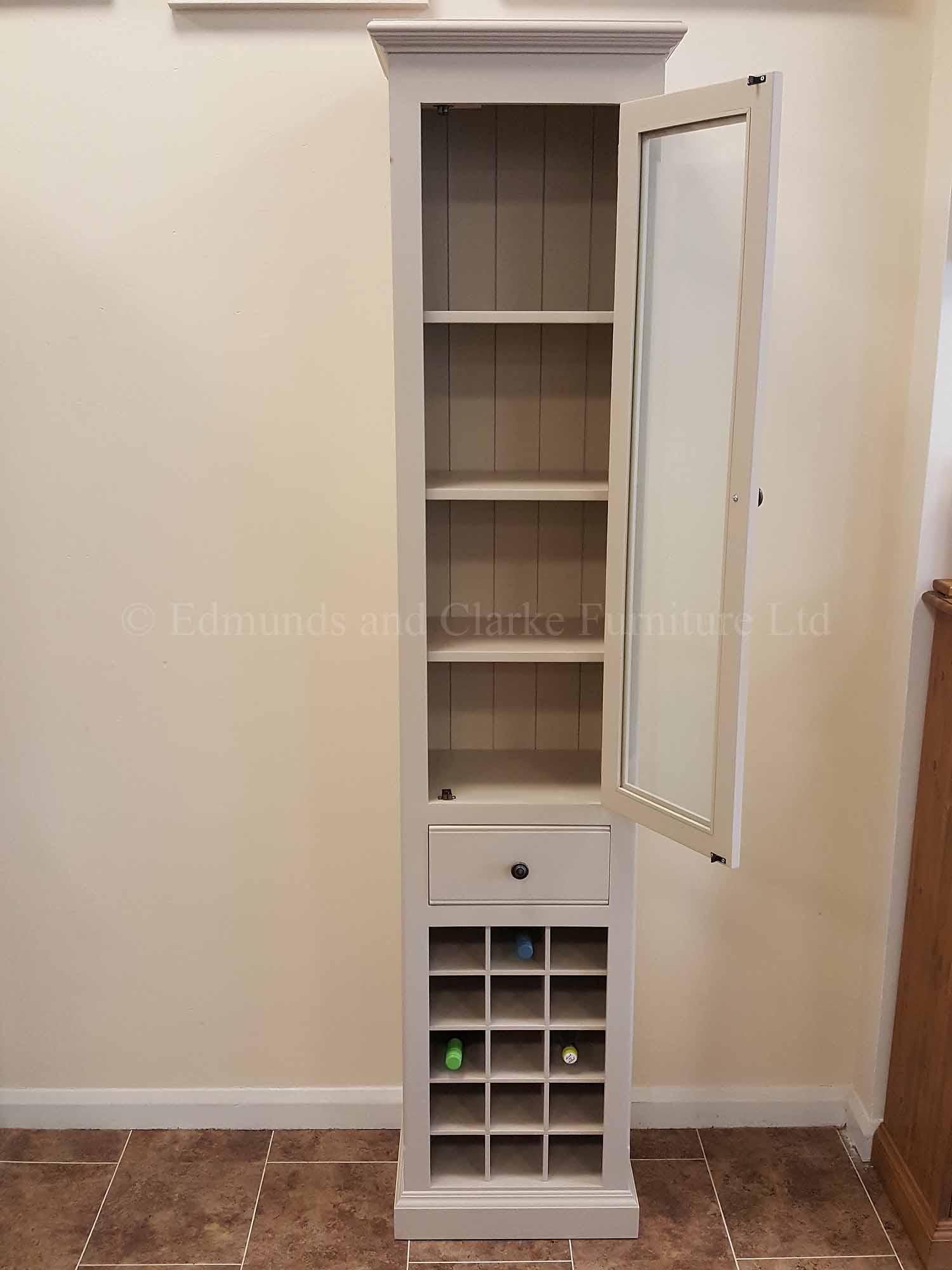 Tall narrow kitchen cupboard with glazed door and wine rack below
