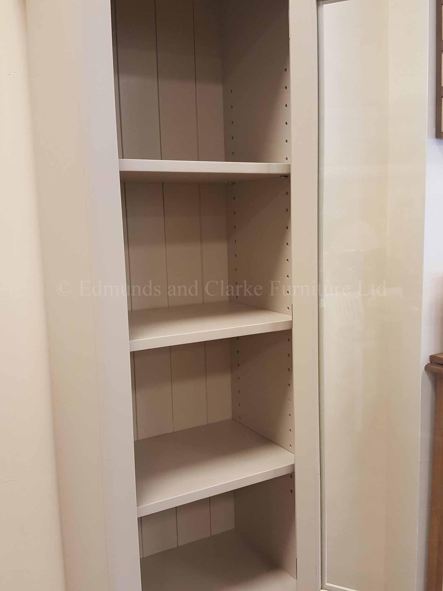 Tall narrow kitchen cupboard with glass door