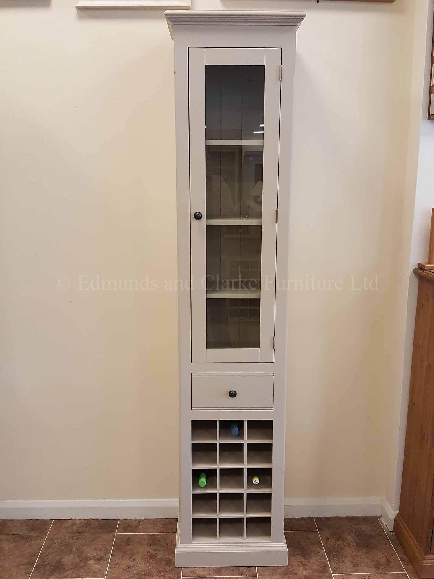 Painted narrow kitchen cupboard with wine rack