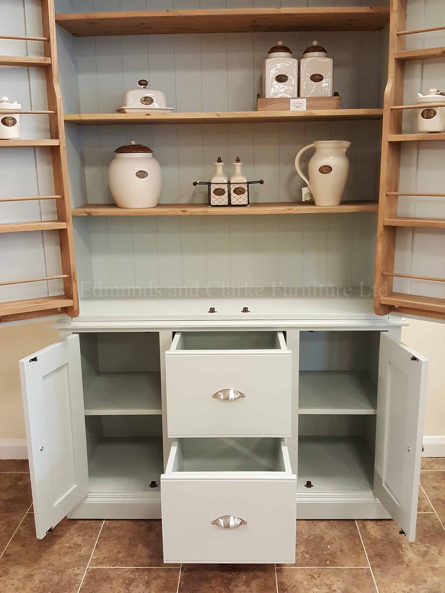 Kitchen larder pantry cupboard made with two large doors above, two central pan drawer and small cupboard below either side of the pan drawers