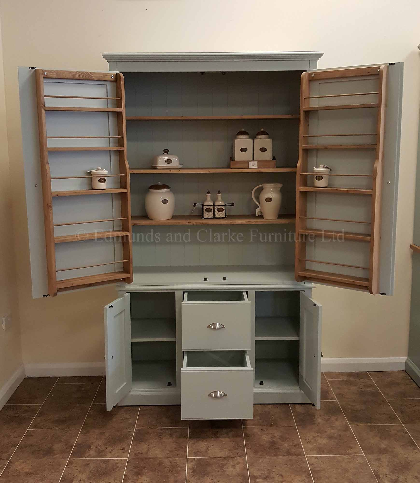 Kitchen larder cupboard painted with internal shelving and spice racks