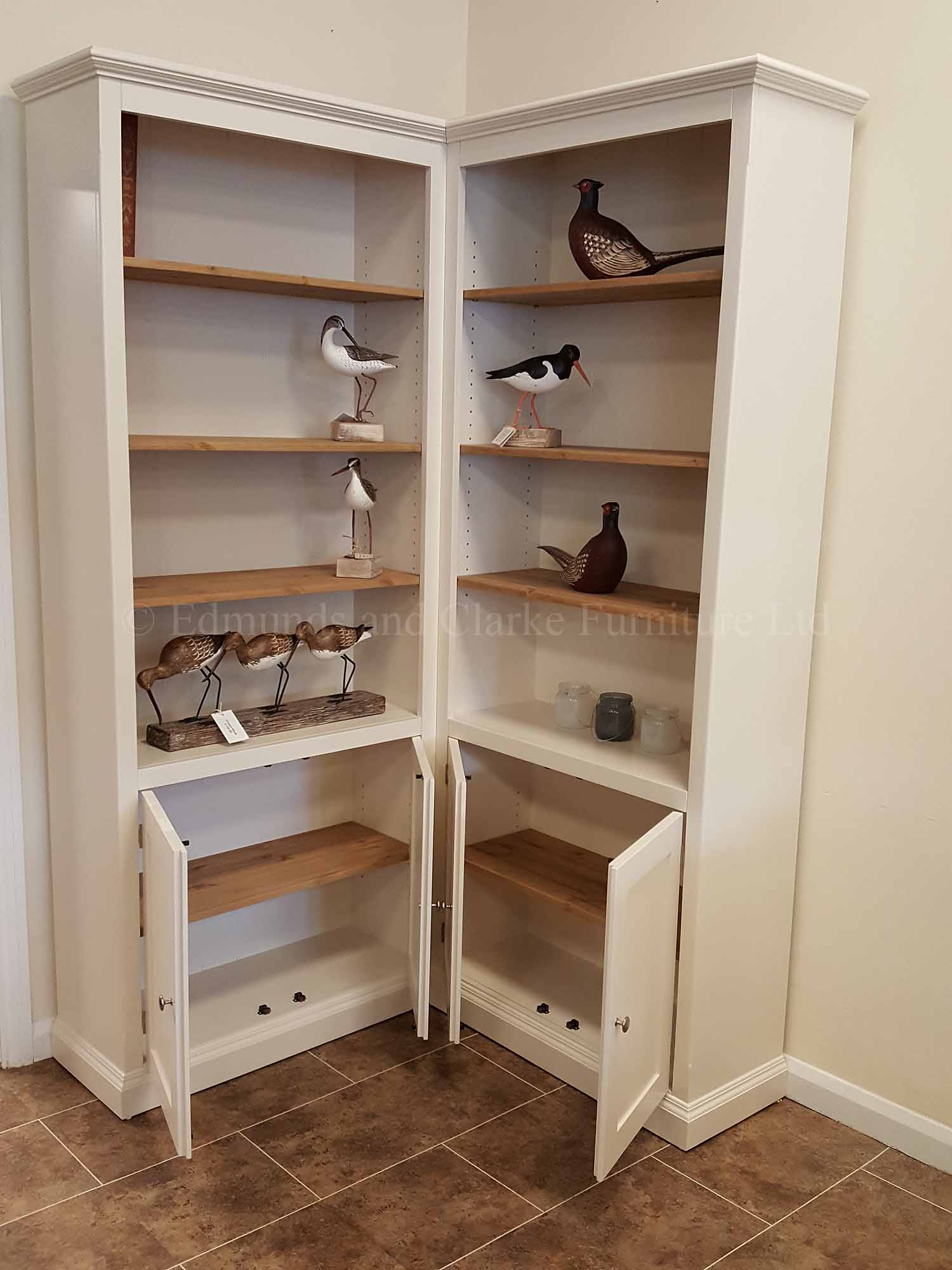 Corner bookcase painted with cupboards below adjustable wooden shelves, painted in a choice of colours