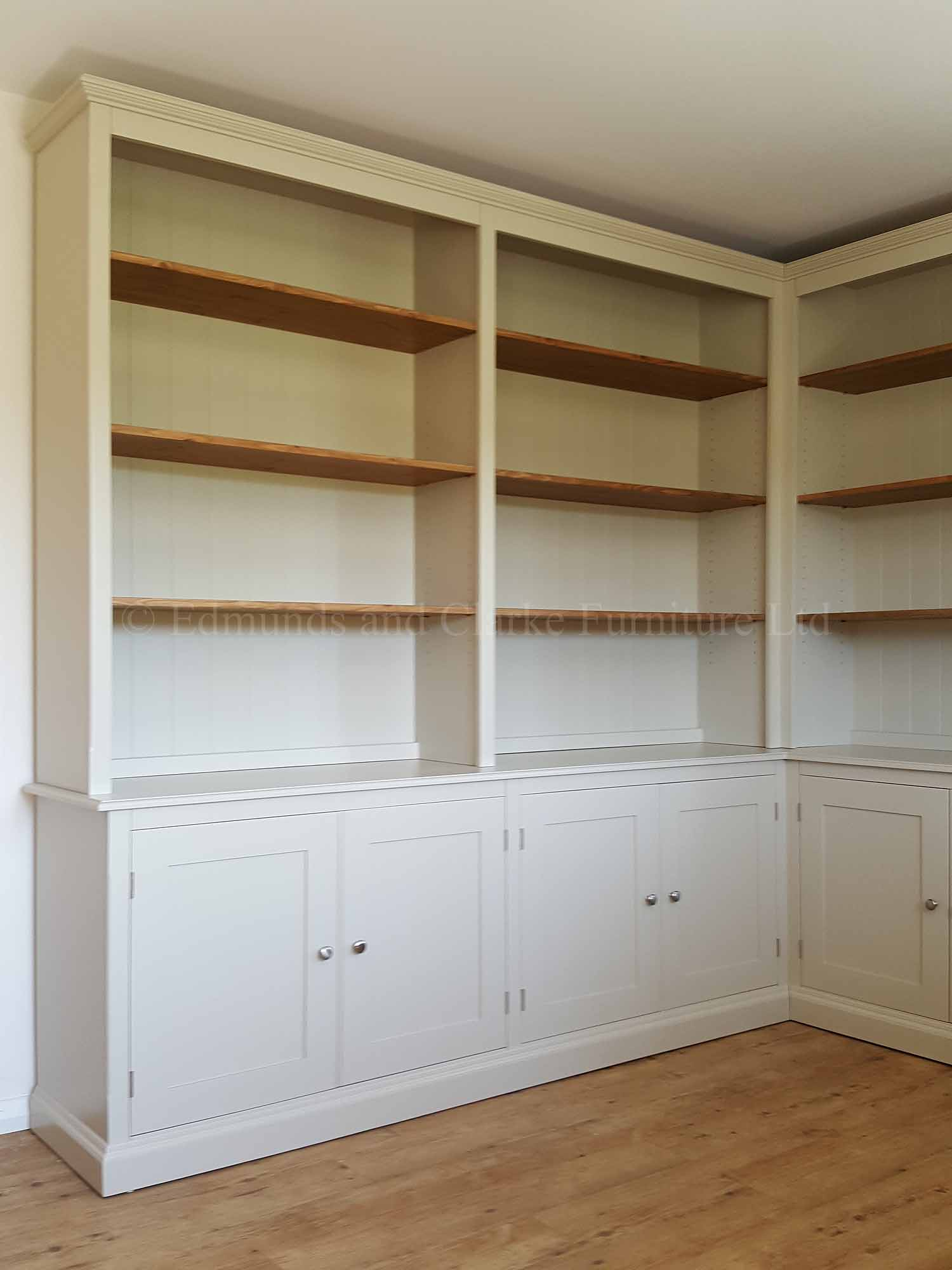 Painted corner bookcase with cupboards below, can be made to measure