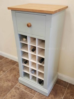 Painted 18 Bottle Wine Rack, main image showing white contrasting wine holders, lacquered oak top and drawer with matching oak knob.