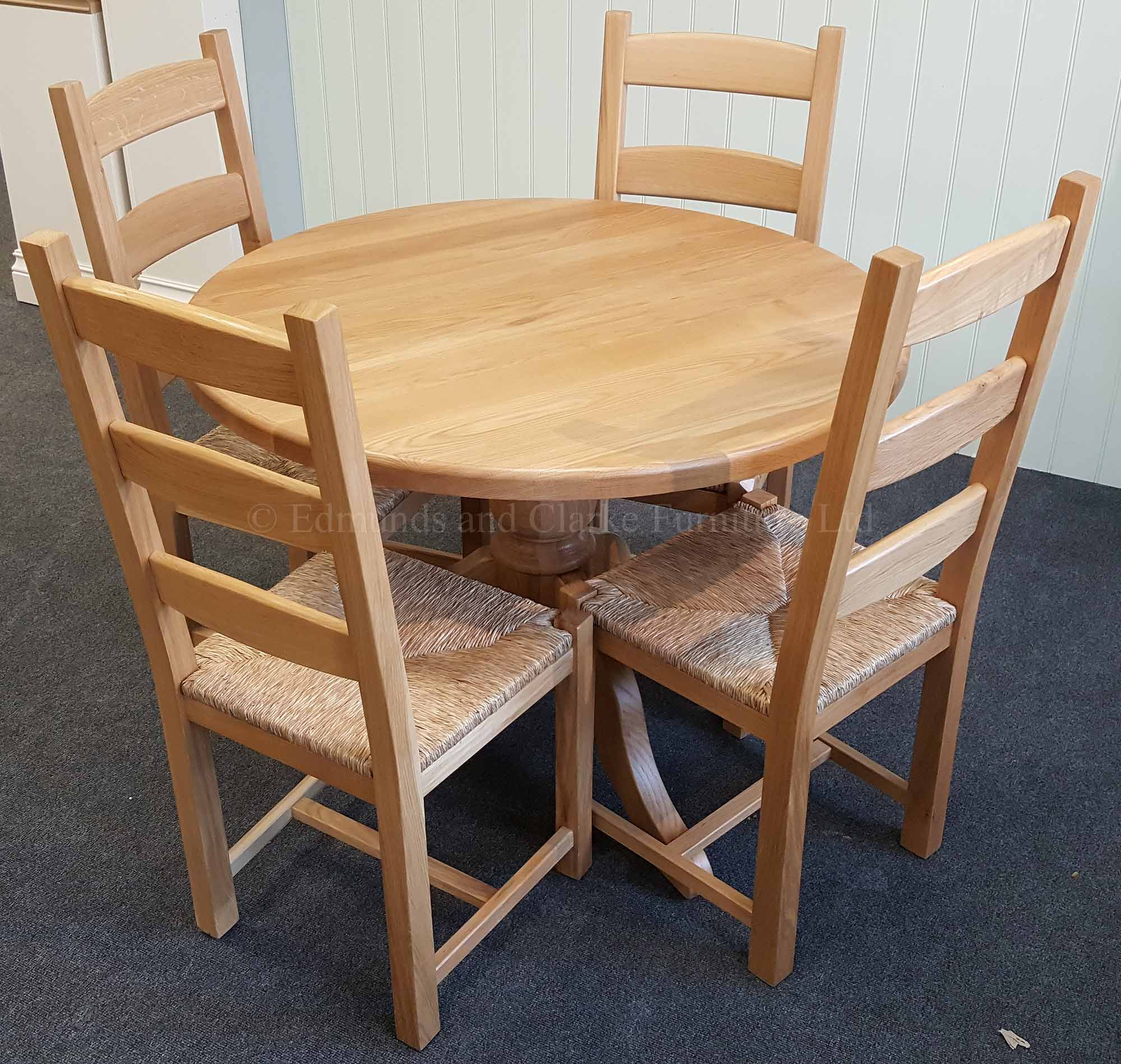 Round solid oak dining table with central pedestal