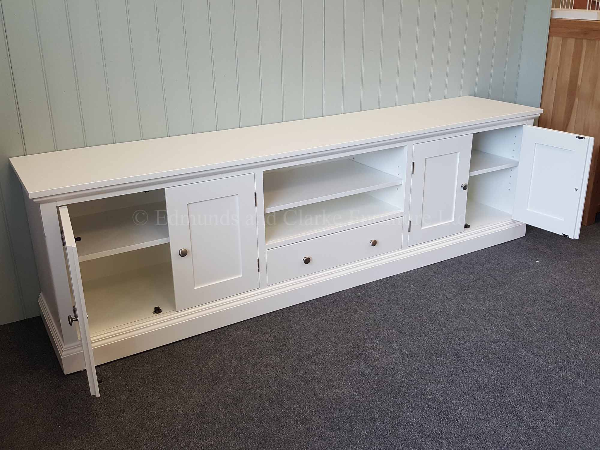 Wide TV entertainment stand painted all over white chrome knobs on four doors and central drawer