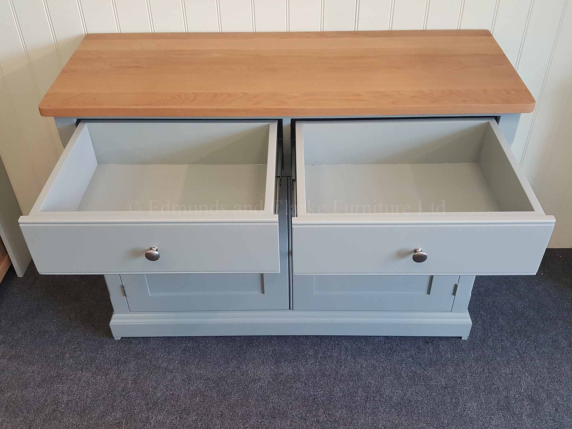 Full extension drawer runners fitted to two drawer sideboard painted with oiled square edge top