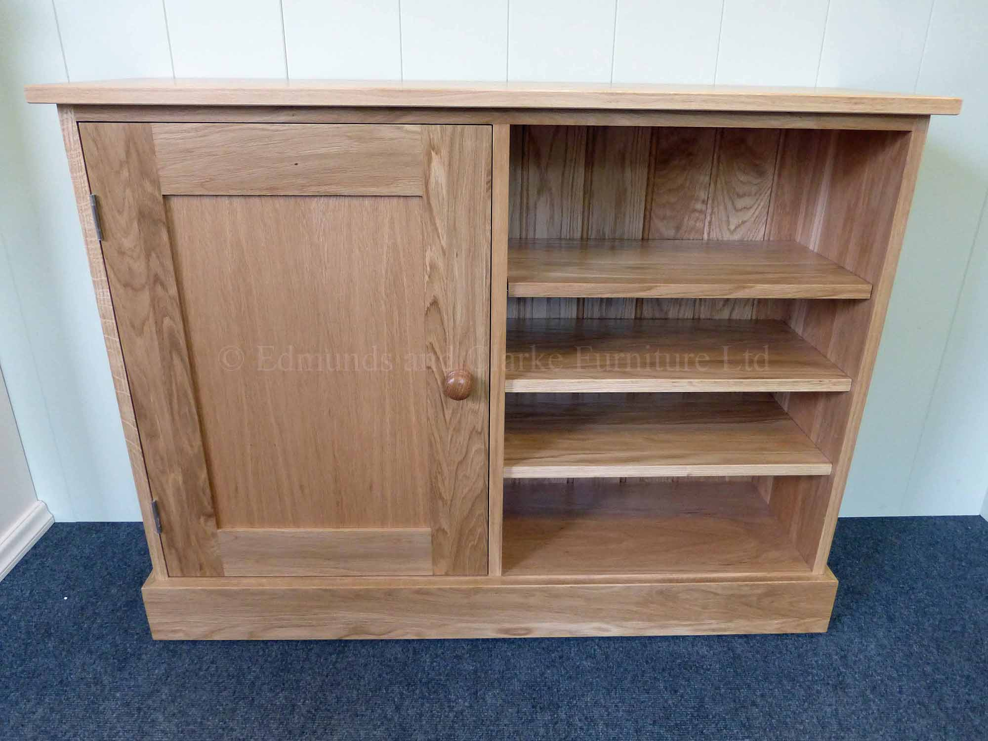 Solid oak multi cupboard paneled door on left with three adjustable shelves on right made all square edge in a shaker design
