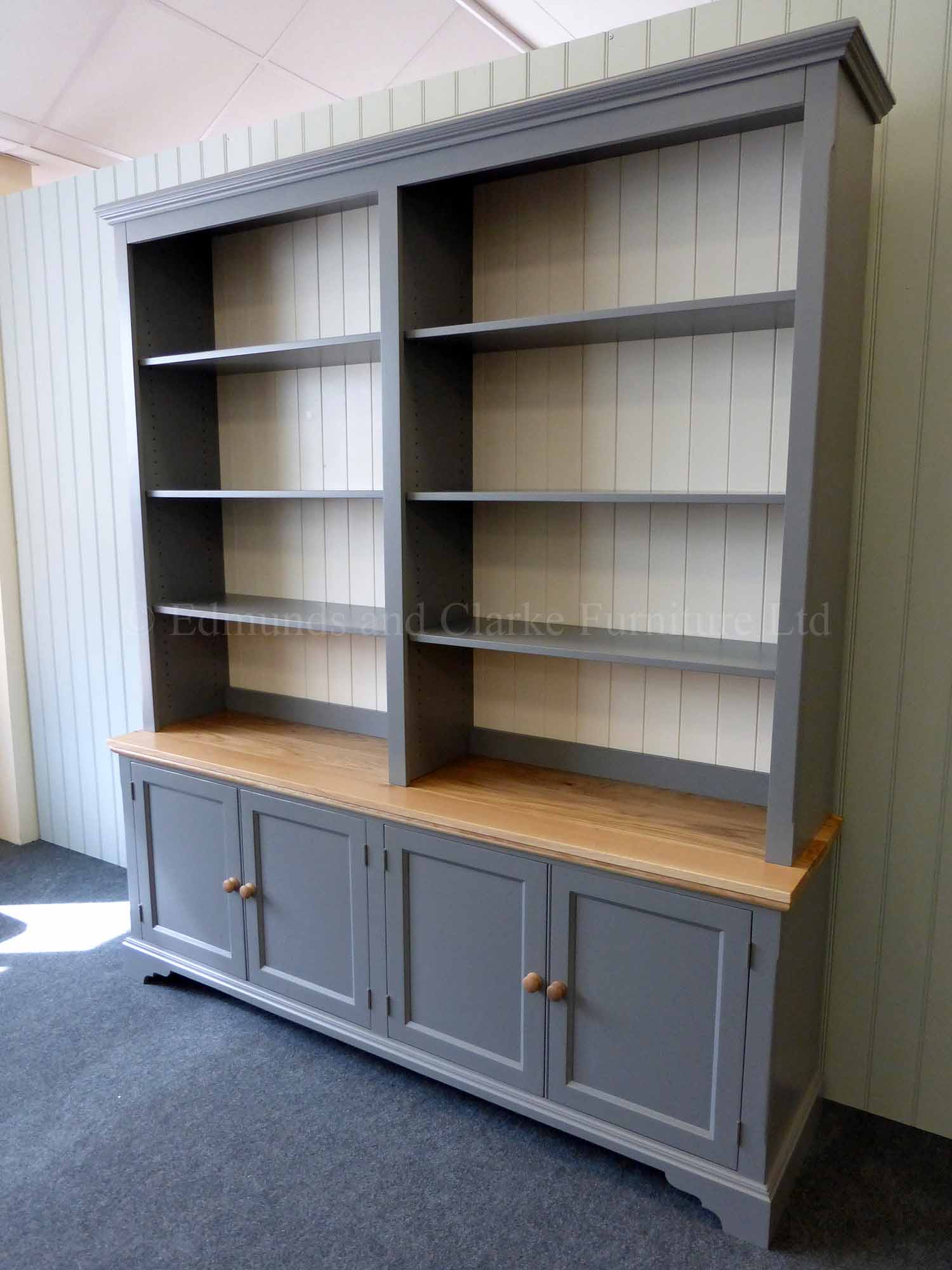 Large painted bookcase with four door deeper cupboard below, solid oak top six adjustable shelves
