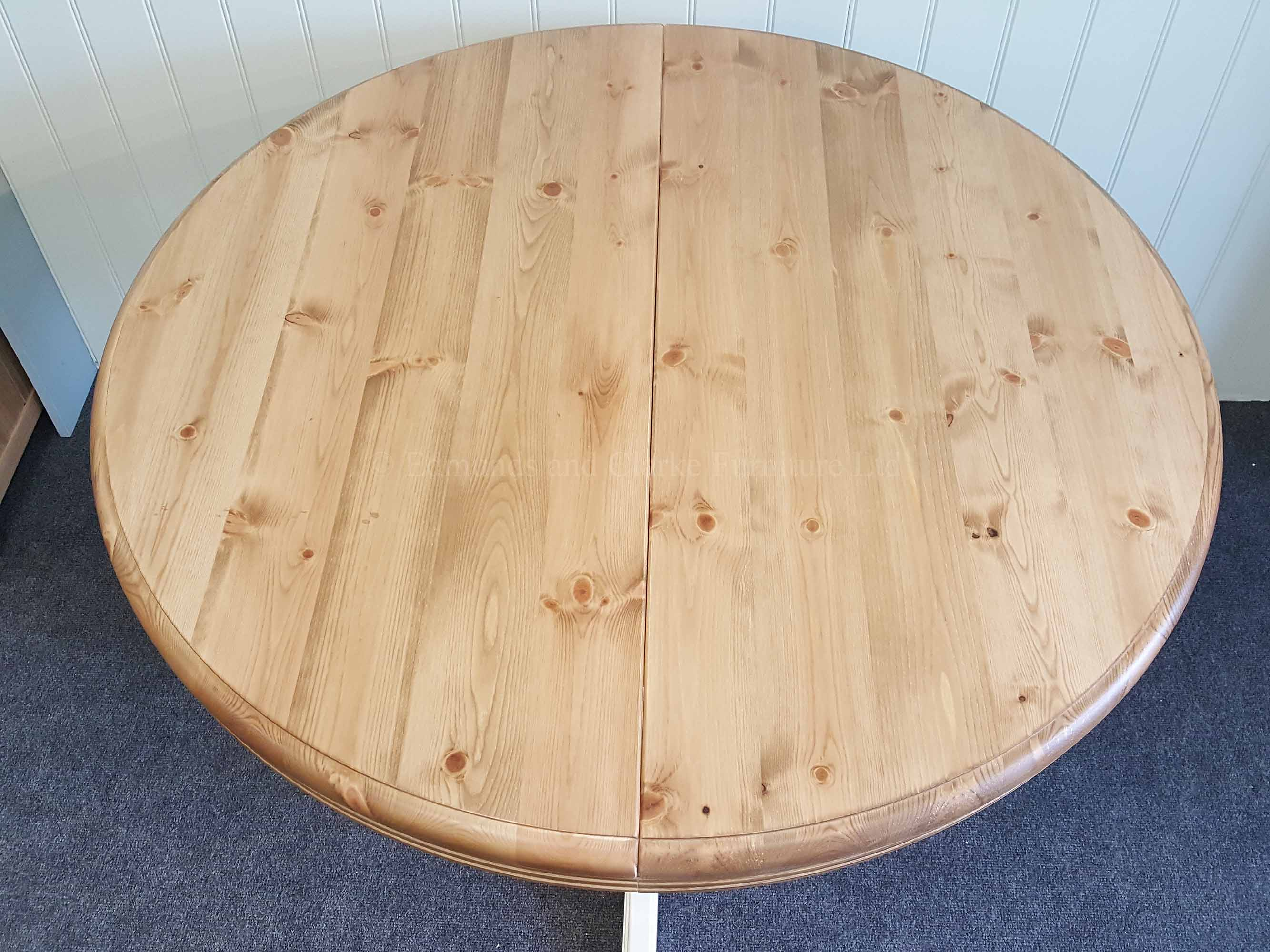 Round extending pine table