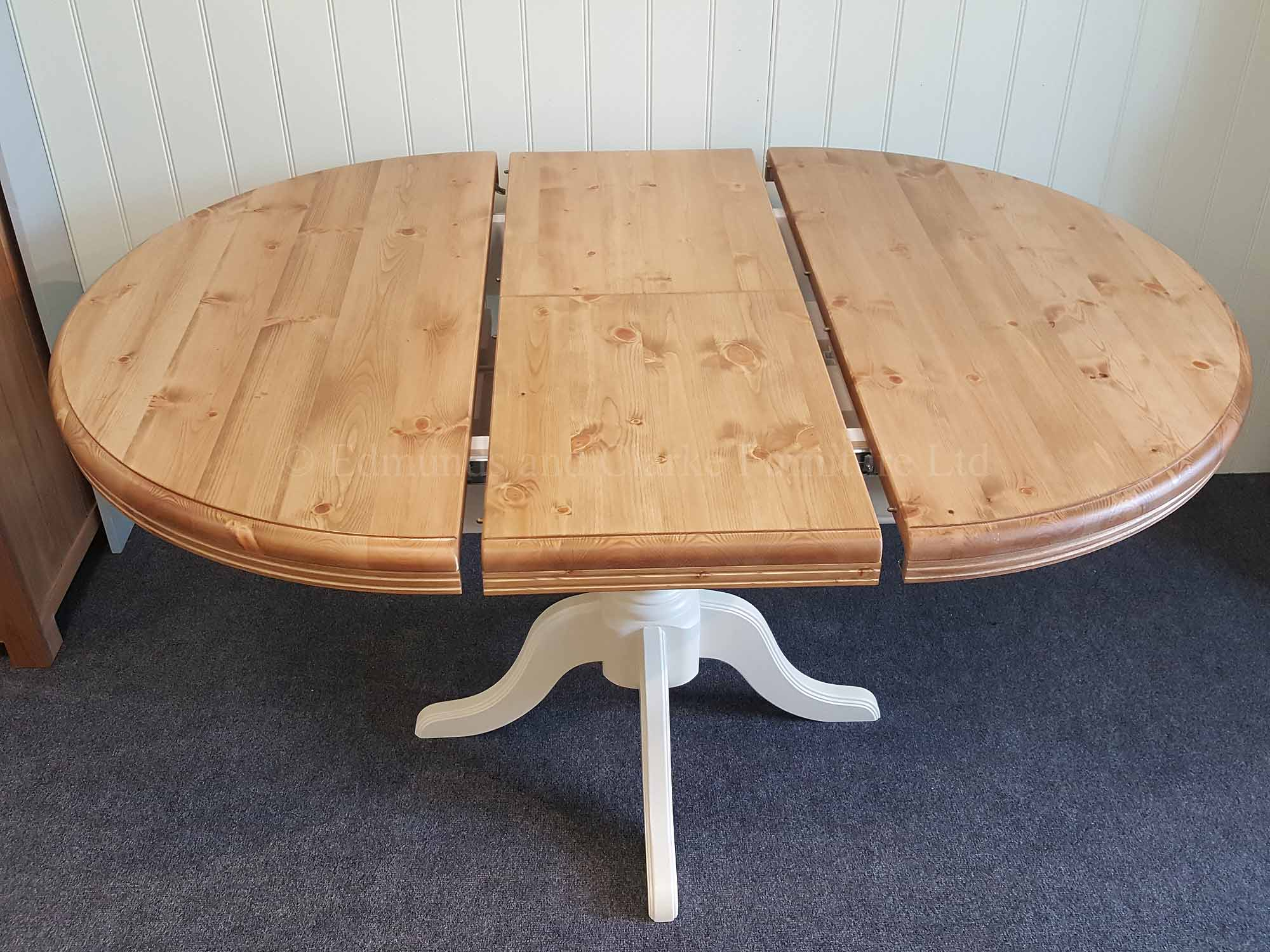 Round pine painted extending table extended with single leaf, oval shape