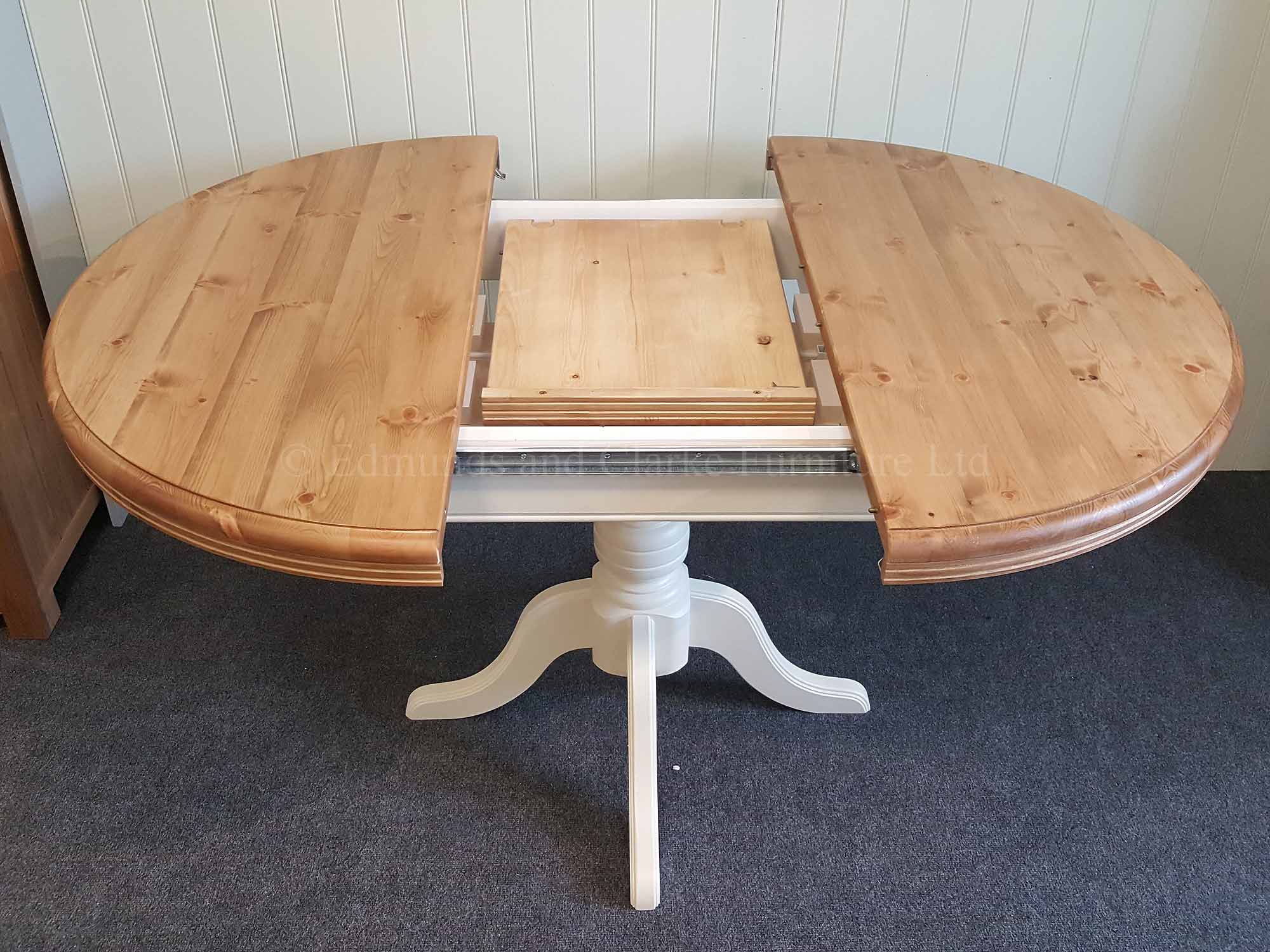 Round pine painted extending table, open with central pedestal