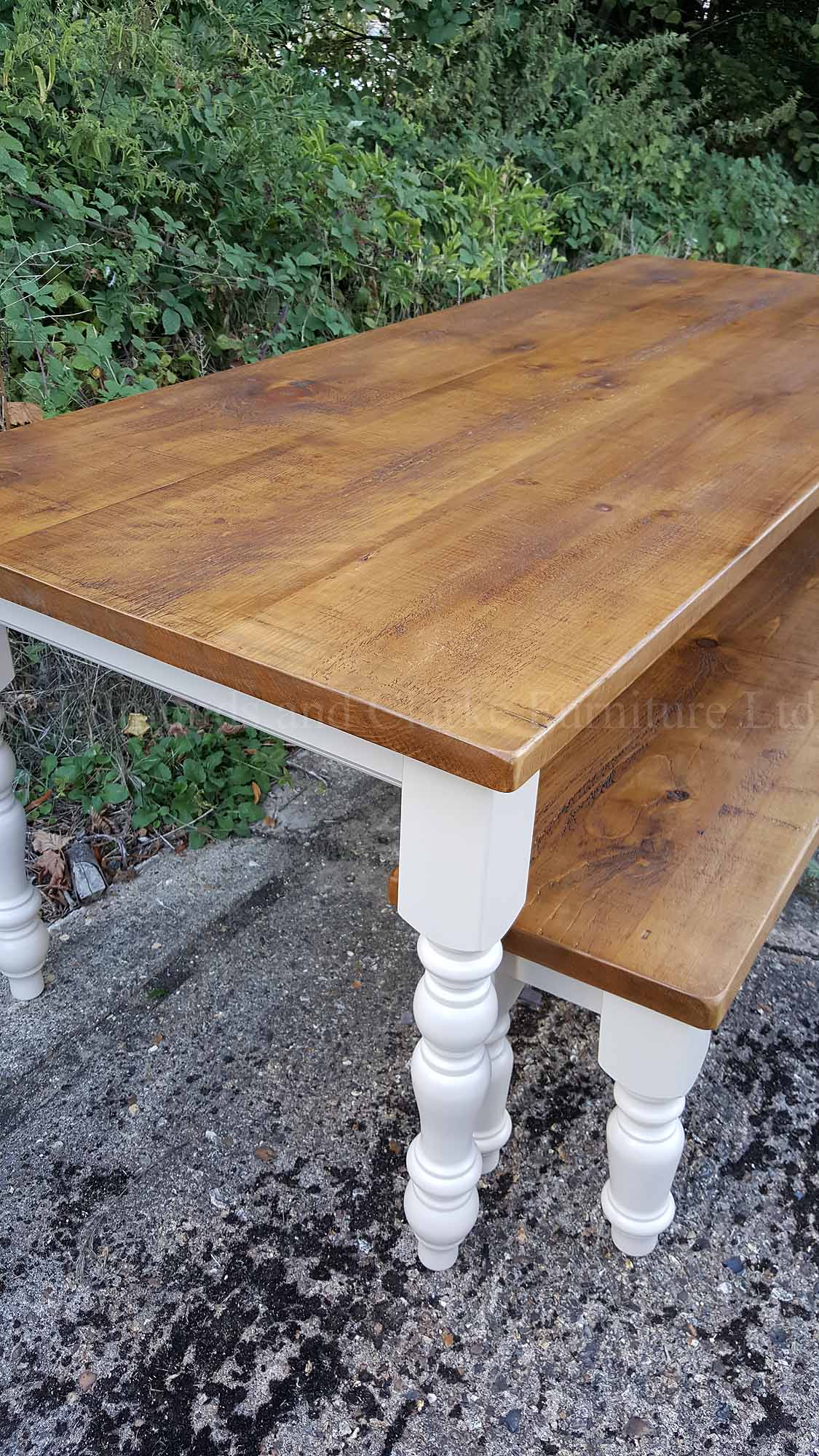 farmhouse table with matching bench painted with rough sawn pine top