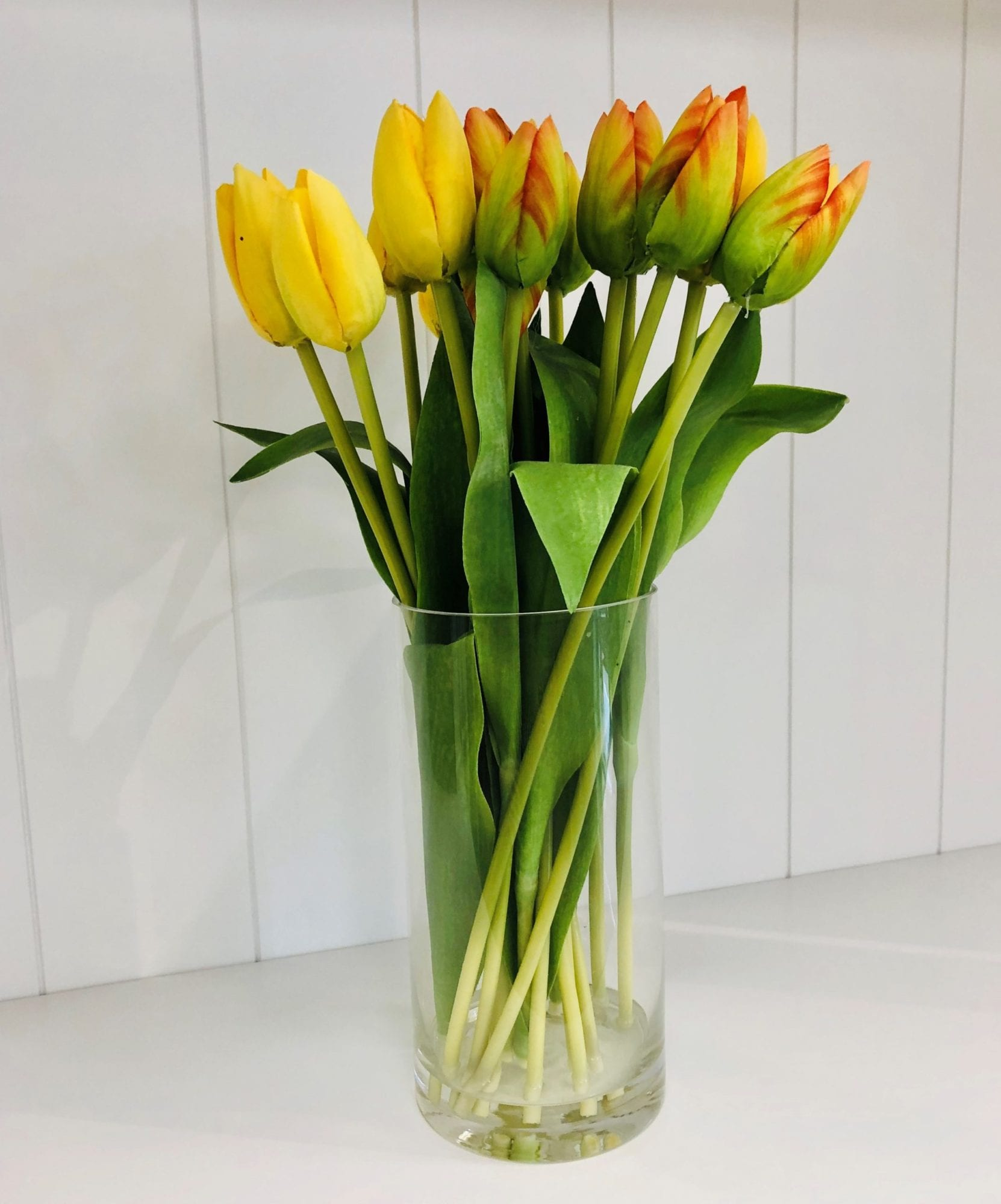 Faux tulips in glass jar