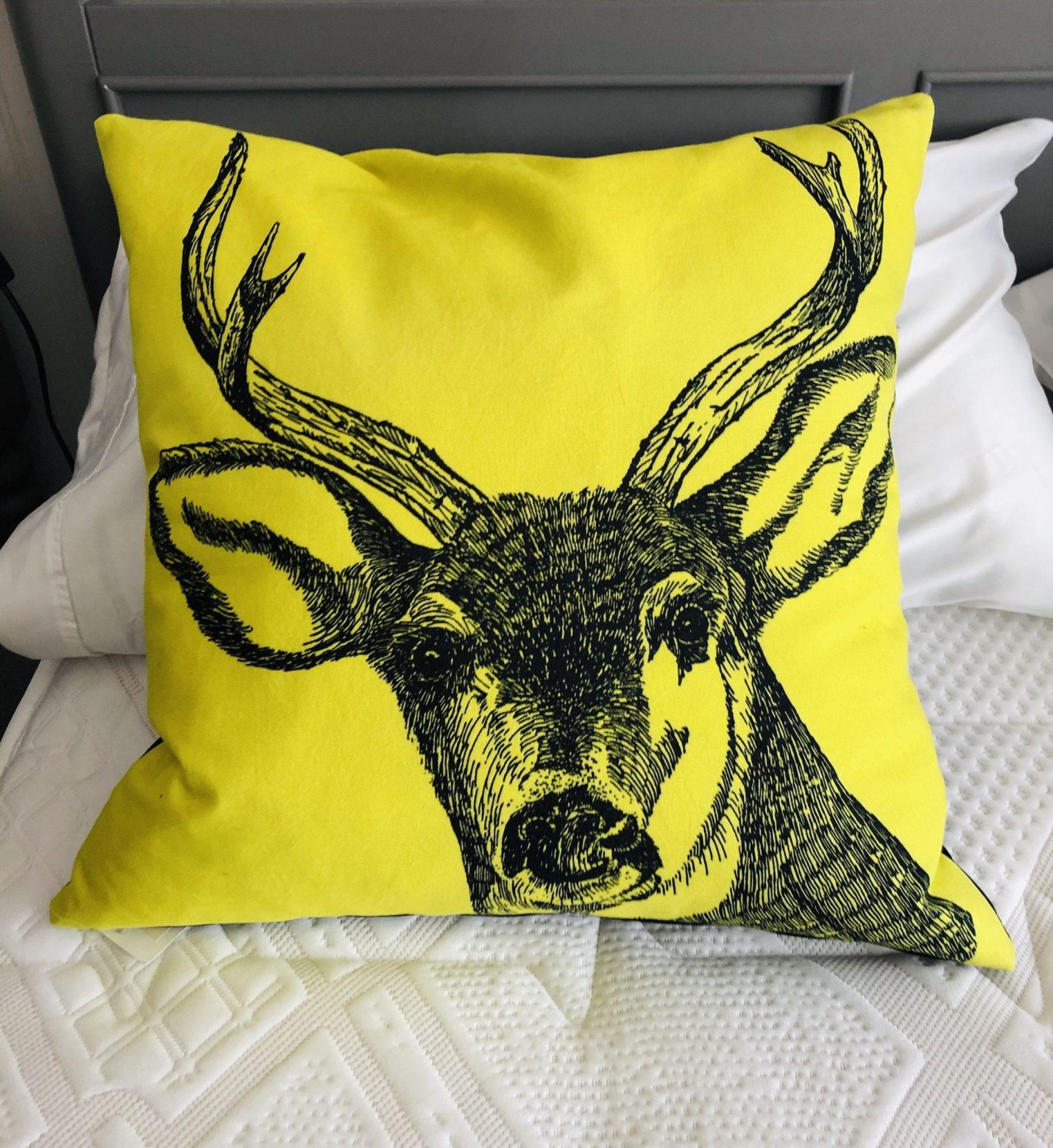 ellow stag cushion Black face