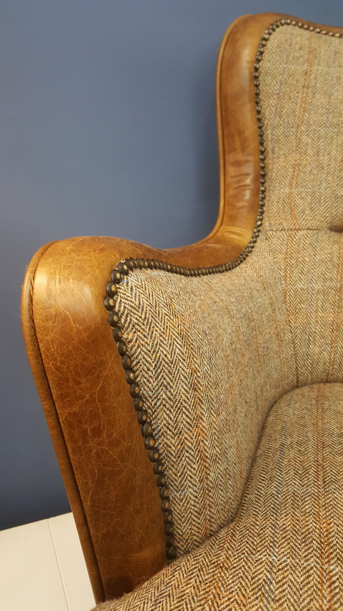 Vintage Sofa Co Ellis FT Chair low slung armchair in hunting lodge harris tweed and cerato leather edging