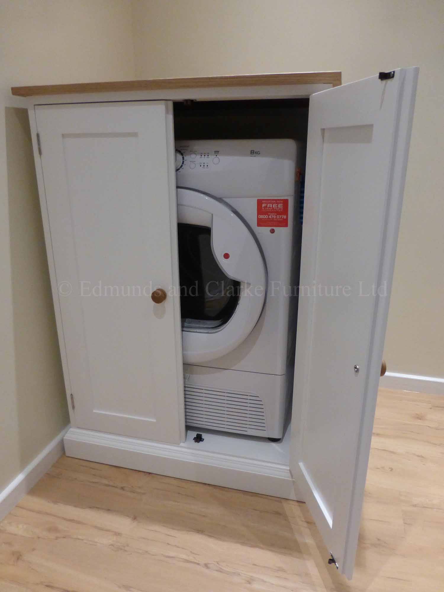 bespoke tumble dryer cupboard with two doors