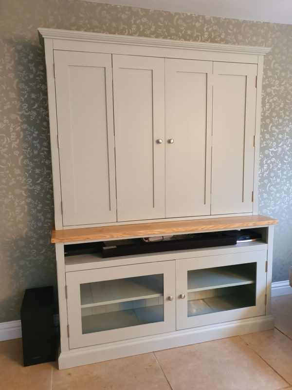 Bespoke Television Cupboard painted with oak top tv hidden behind bifold doors