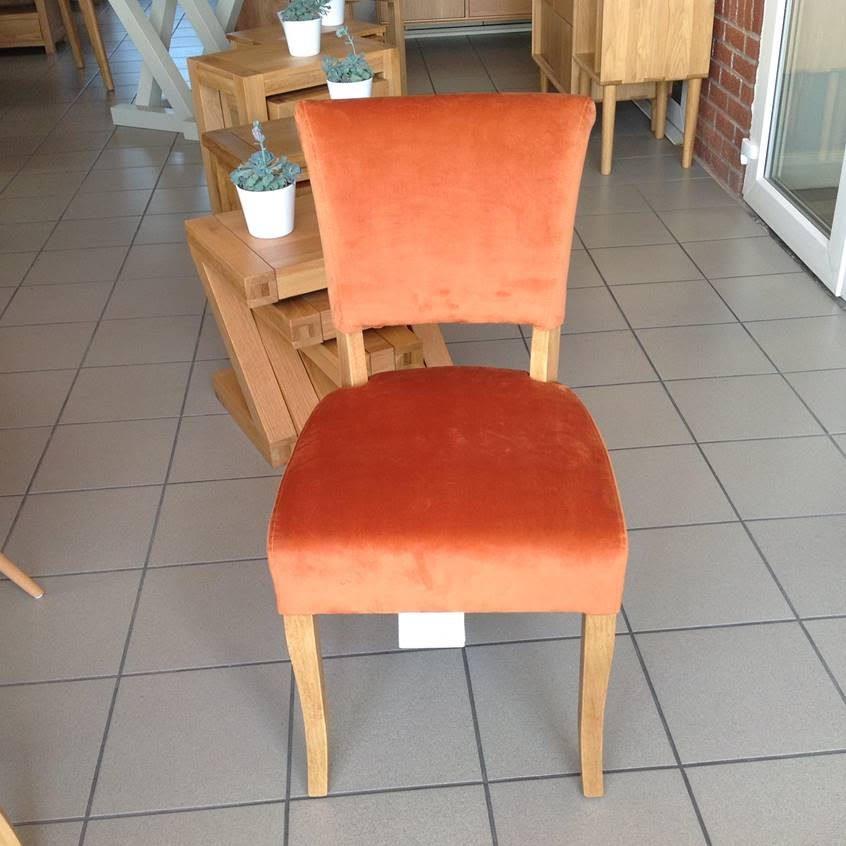 Capri velvet dining chair in burnt orange and oak legs