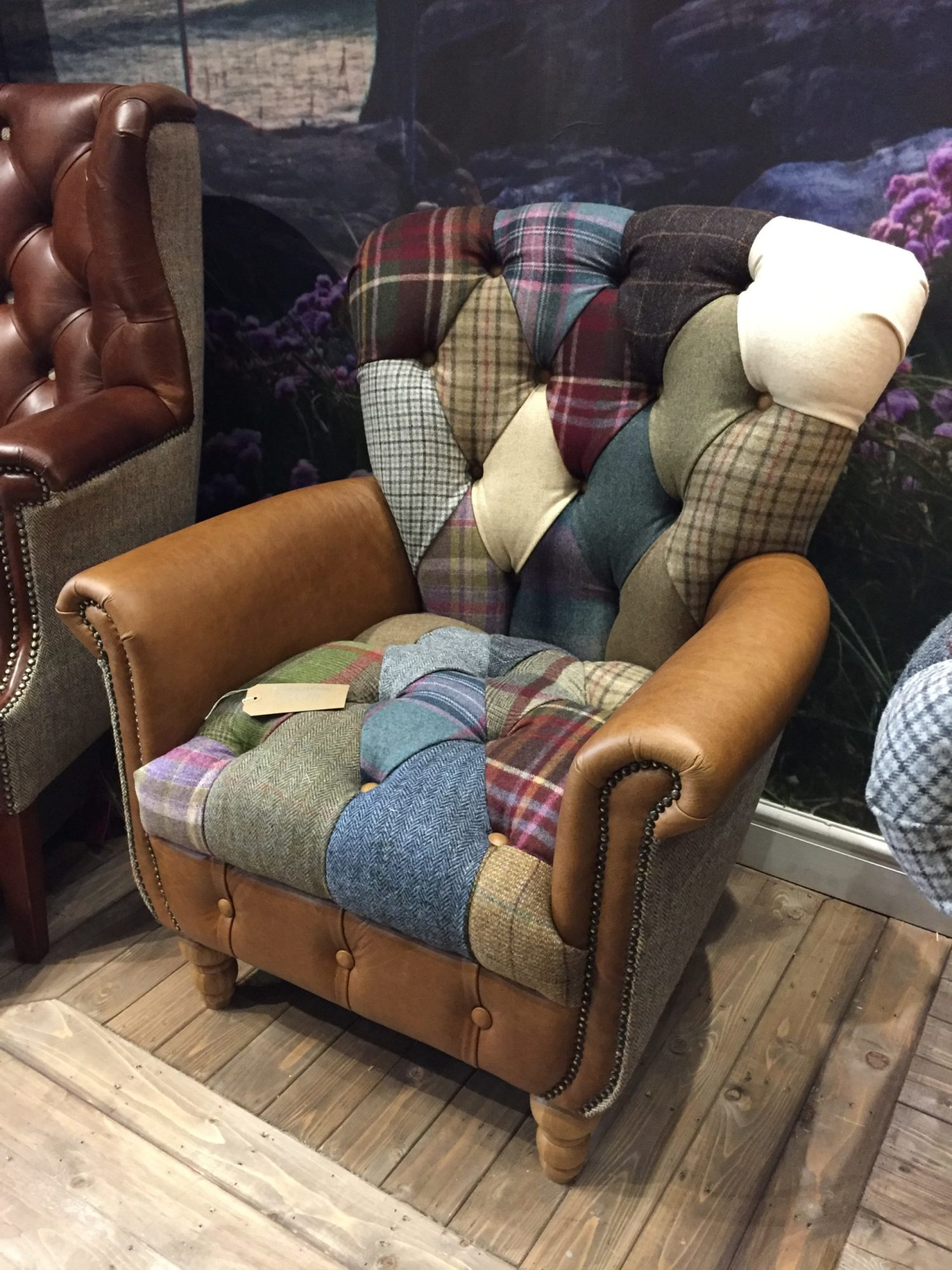 Vintage Sofa Co Gotham Harlequin Fast Track Chair in patchwork harris tweed and wool fabric with cerato brown leather arms and detailing on turned oak legs in showroom