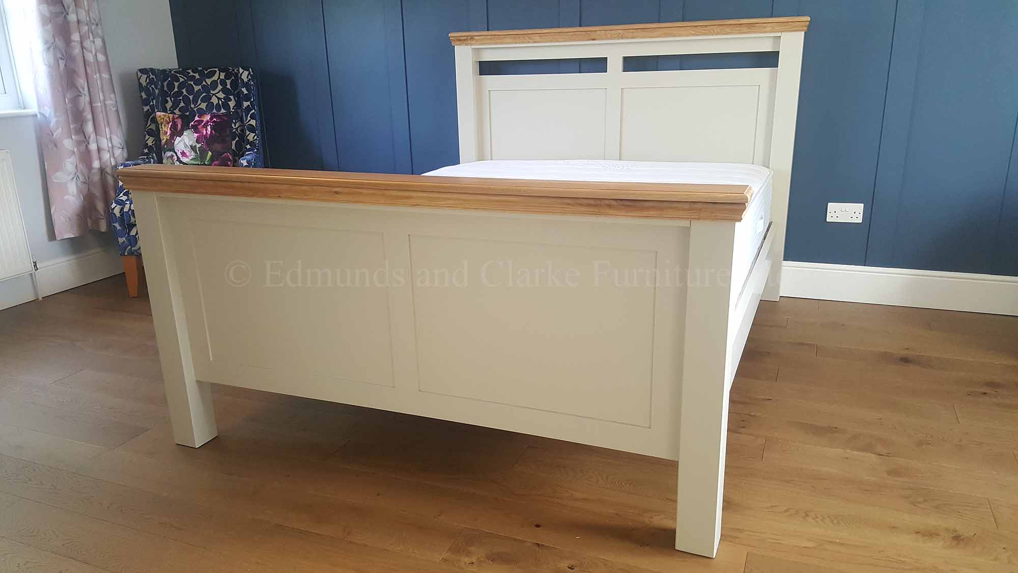 kingsize panelled high end bed with oak cappings