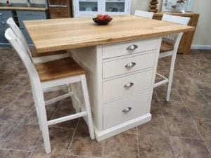 Breakfast bar with four drawers and space for four bar stools, painted ivory with solid oak top
