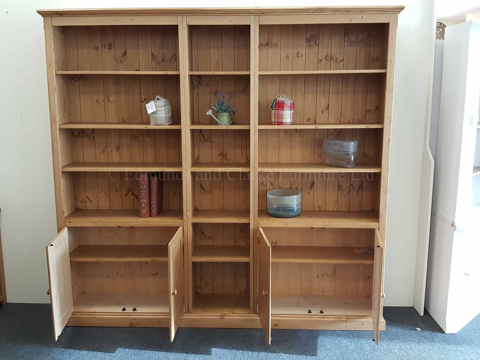 Bespoke pine wide bookcase with doors and adjustable shelves