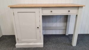 Single pedestal office desk with single cupboard and drawer above kneeholeboard