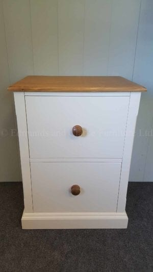 two drawer filing cabinet painted white withwaxed pine top and knobs