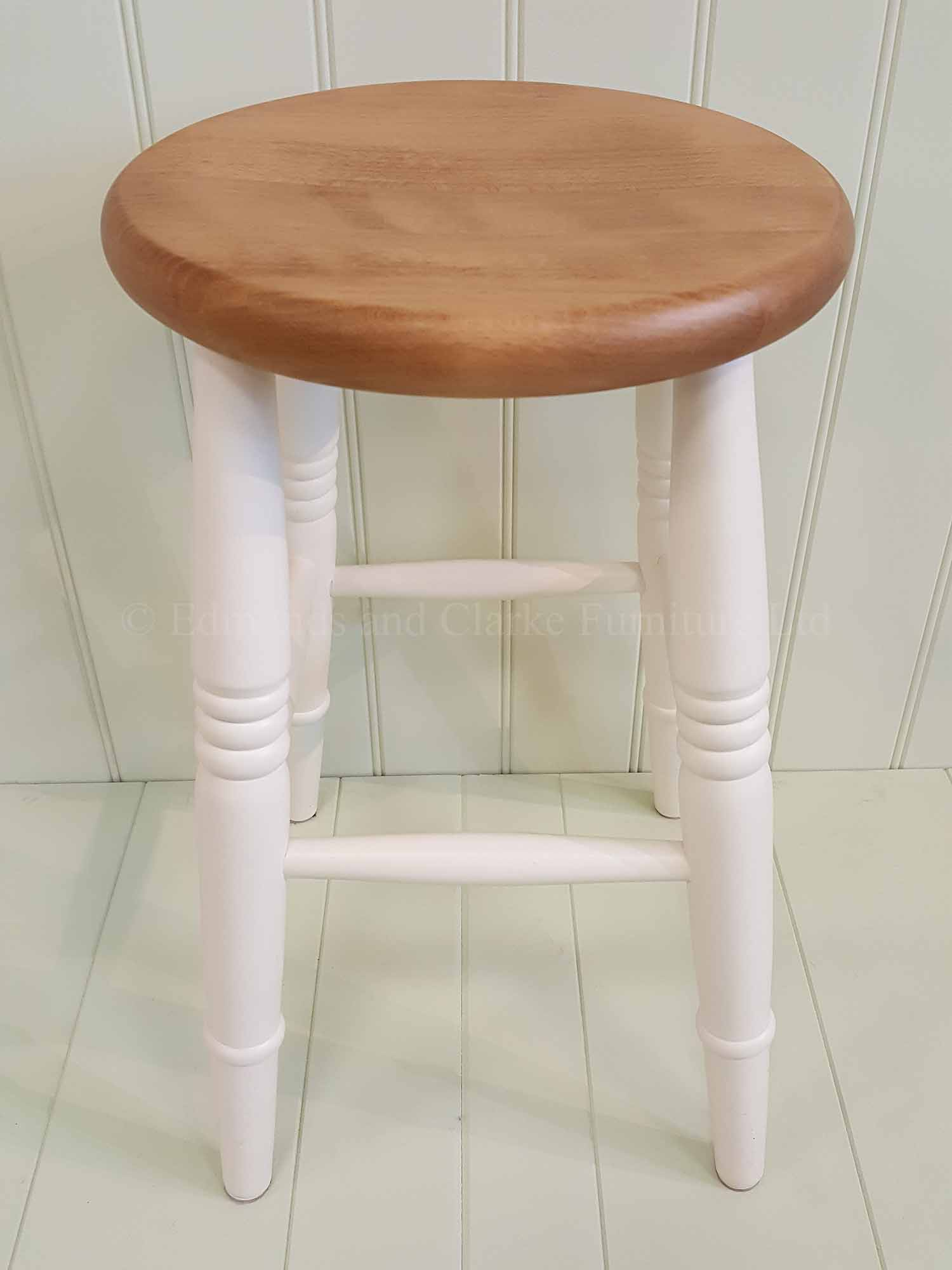 Low farmhouse stool painted with pine seat