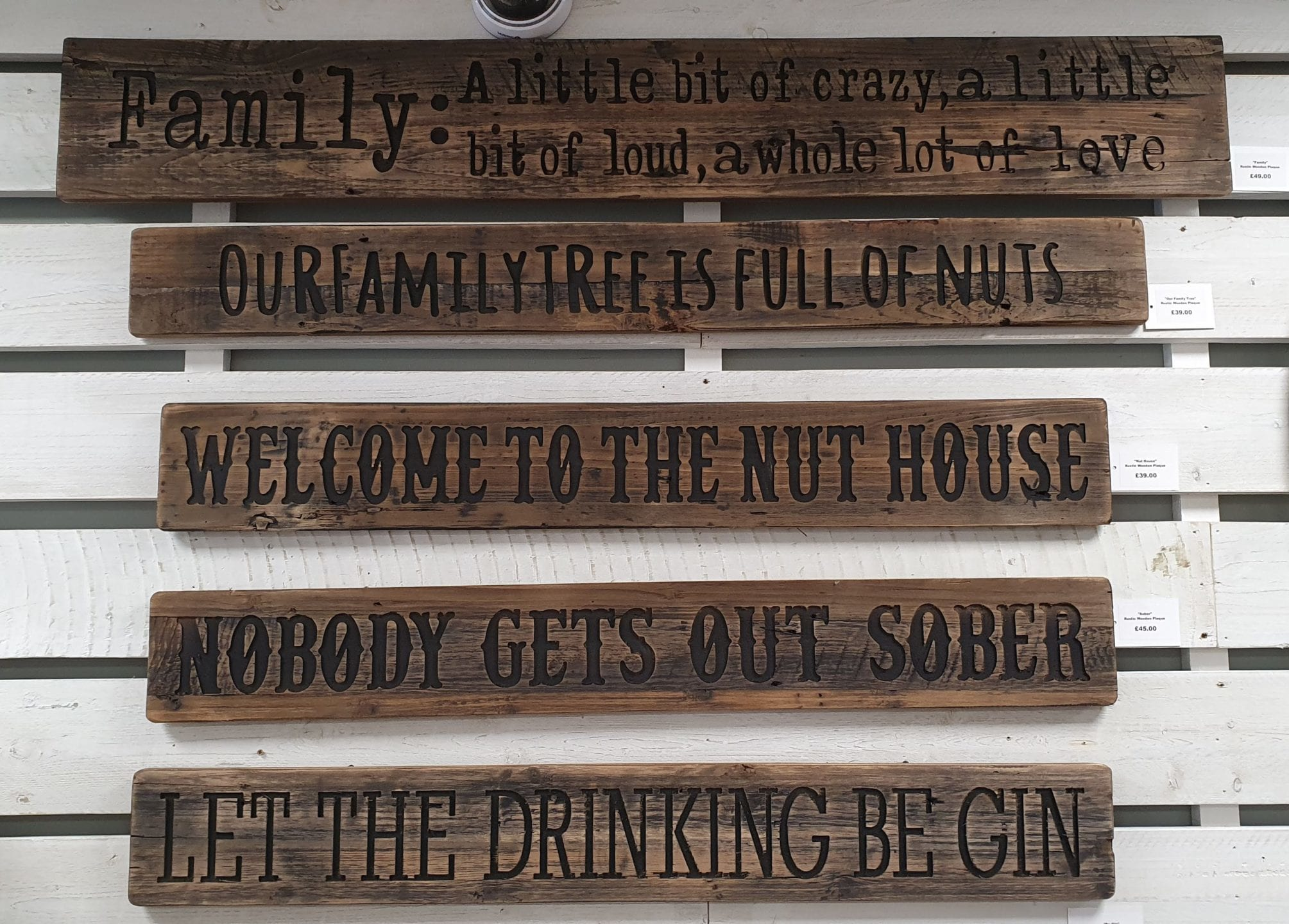 Five Rustic Wooden engraved Plaques, hung on wall, grouped together