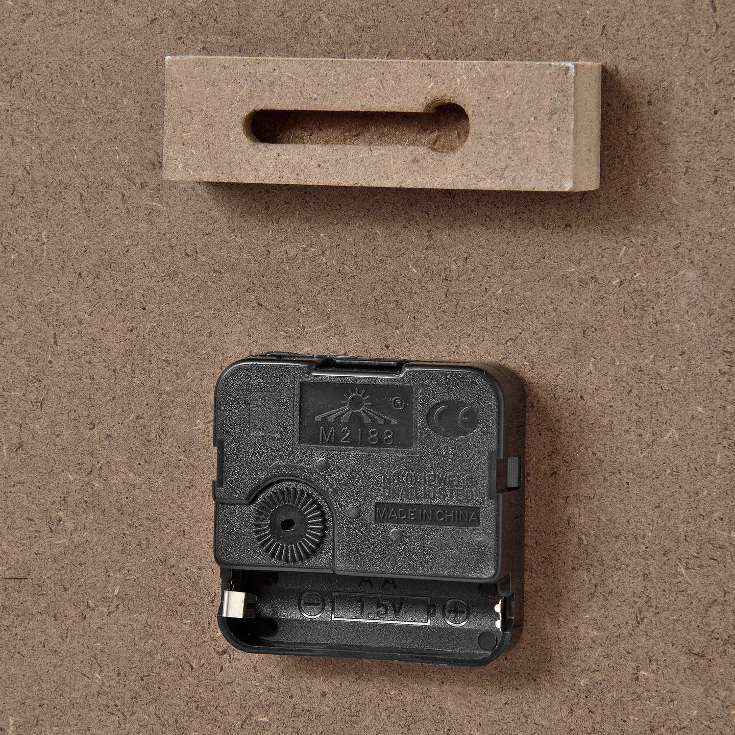 family rules clock back showing hang hook and battery