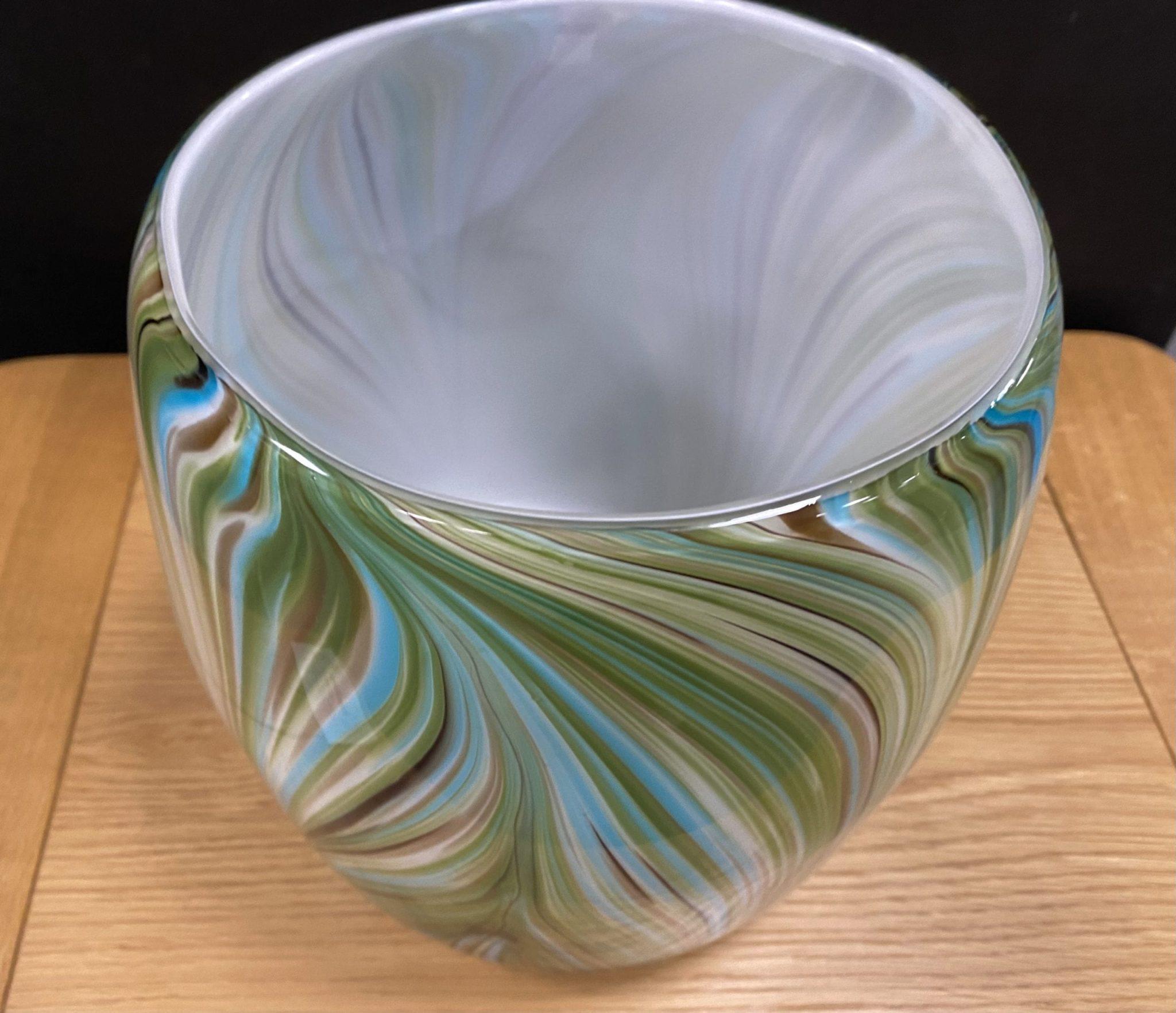 Waves of green round vase room shot