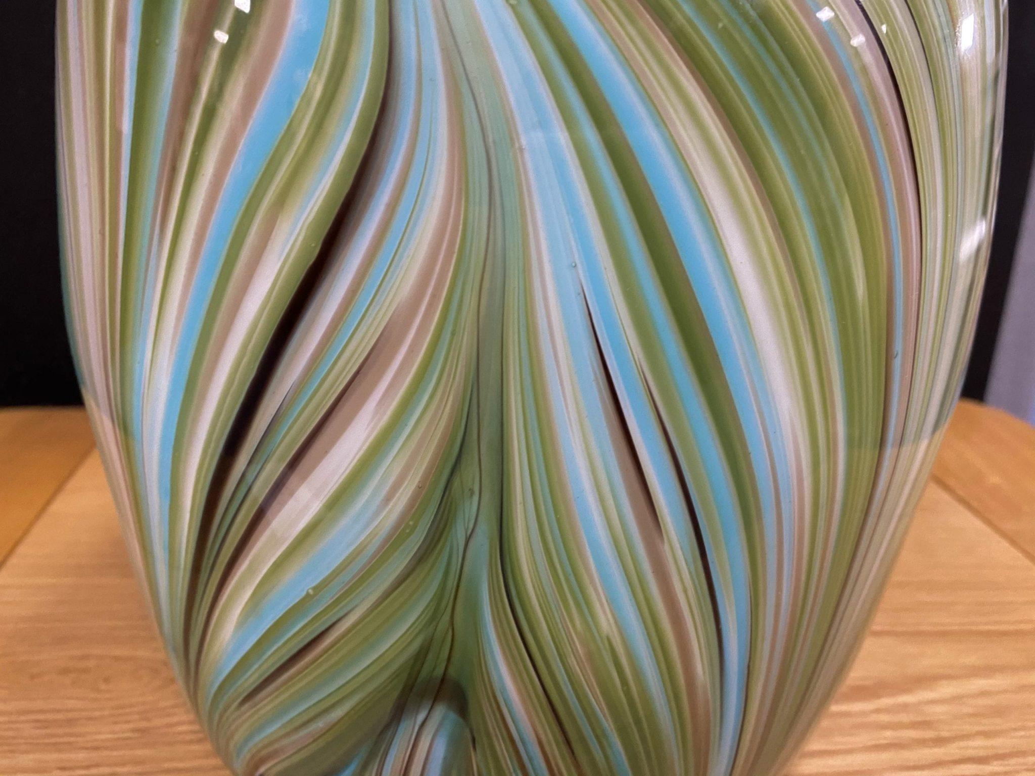 Waves of green vase close up