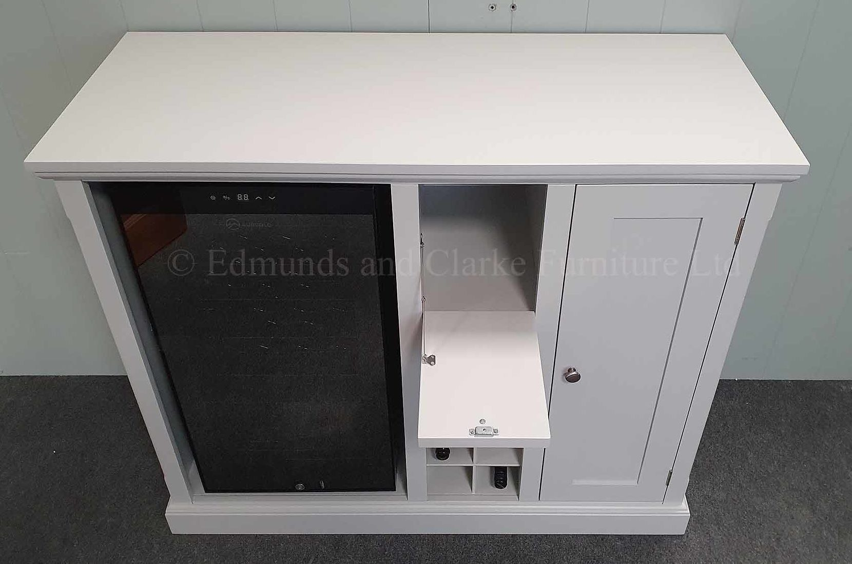 Sideboard including drinks fridge drop down tray for pouring glasses of wine